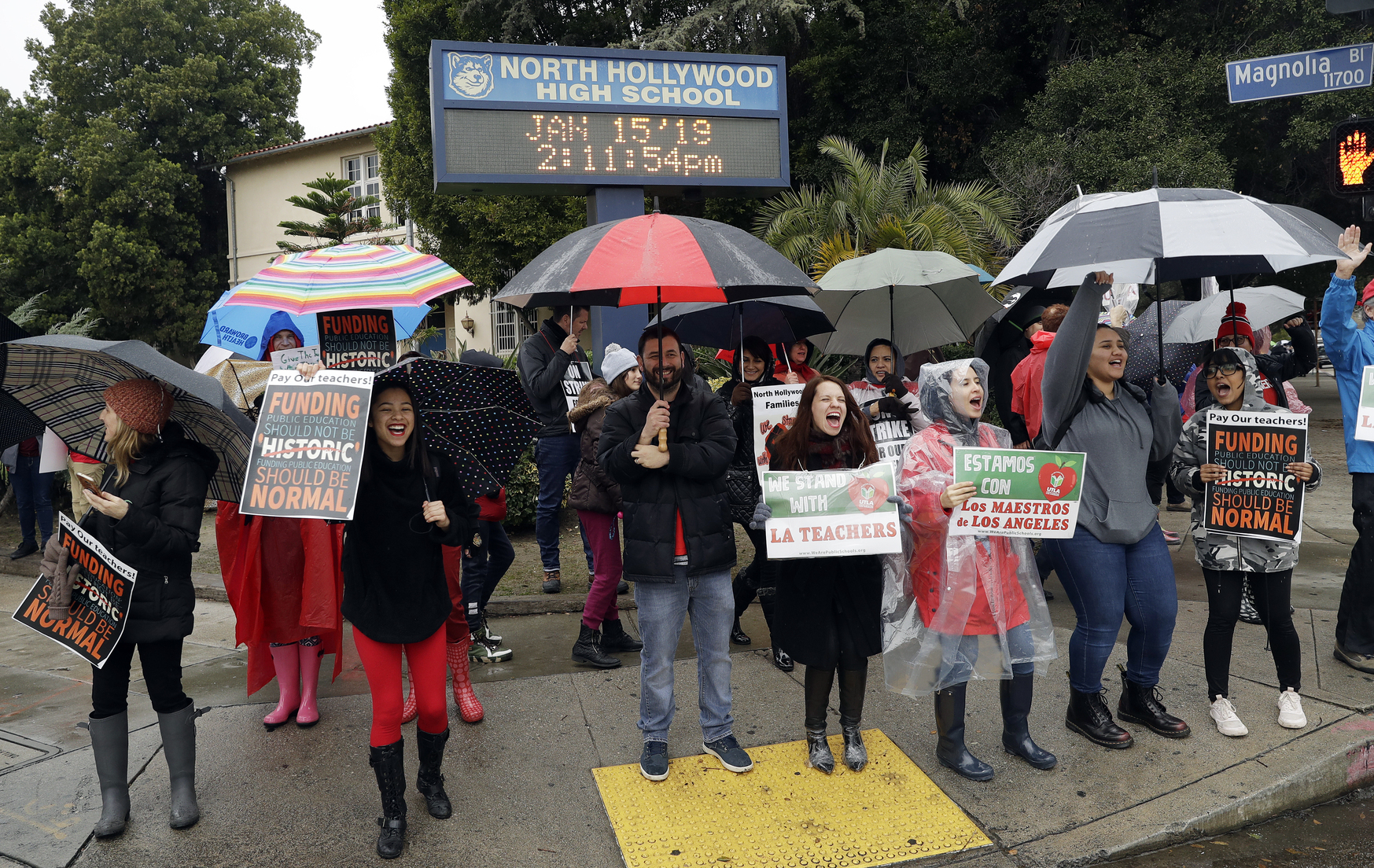 <div class='meta'><div class='origin-logo' data-origin='AP'></div><span class='caption-text' data-credit='Marcio Jose Sanchez'>Teachers and students shout slogans during a rally outside out of North Hollywood High School.</span></div>