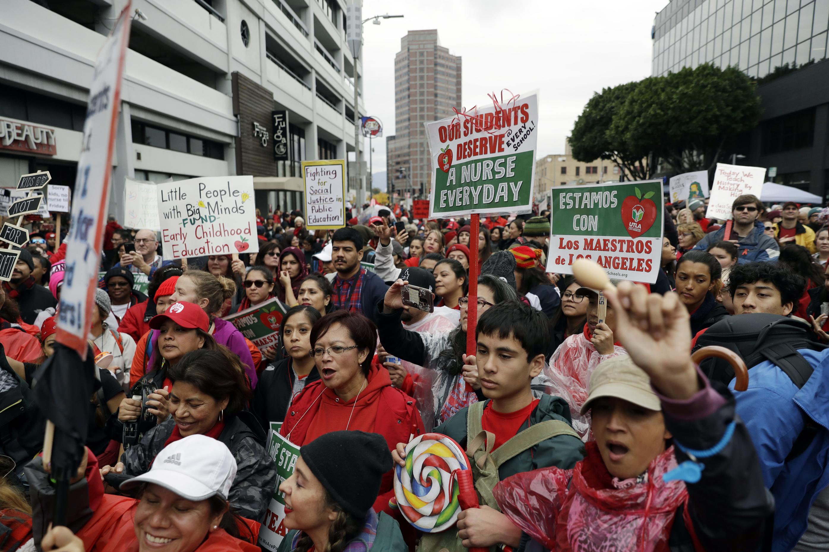 <div class='meta'><div class='origin-logo' data-origin='AP'></div><span class='caption-text' data-credit='Jose Sanchez'>Demonstrators gather during a teachers rally in Downtown LA.</span></div>