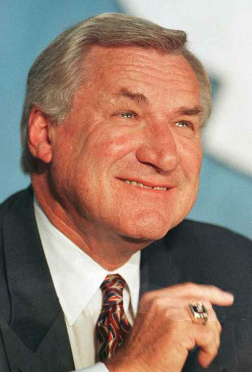 "<div class=""meta image-caption""><div class=""origin-logo origin-image none""><span>none</span></div><span class=""caption-text"">In an Oct. 9, 1997 file photo, North Carolina basketball coach Dean Smith smiles during a news conference in Chapel Hill, N.C.,where he announced his retirement. (AP Photo/Bob Jordan, File)</span></div>"
