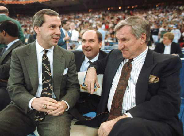 "<div class=""meta image-caption""><div class=""origin-logo origin-image none""><span>none</span></div><span class=""caption-text"">March 30, 1991, Kansas coach Roy Williams, left, and North Carolina coach Dean Smith talk before the start of the first NCAA national semi-final game in Indianapolis, Ind. (AP Photo/Bob Jordan, File)</span></div>"