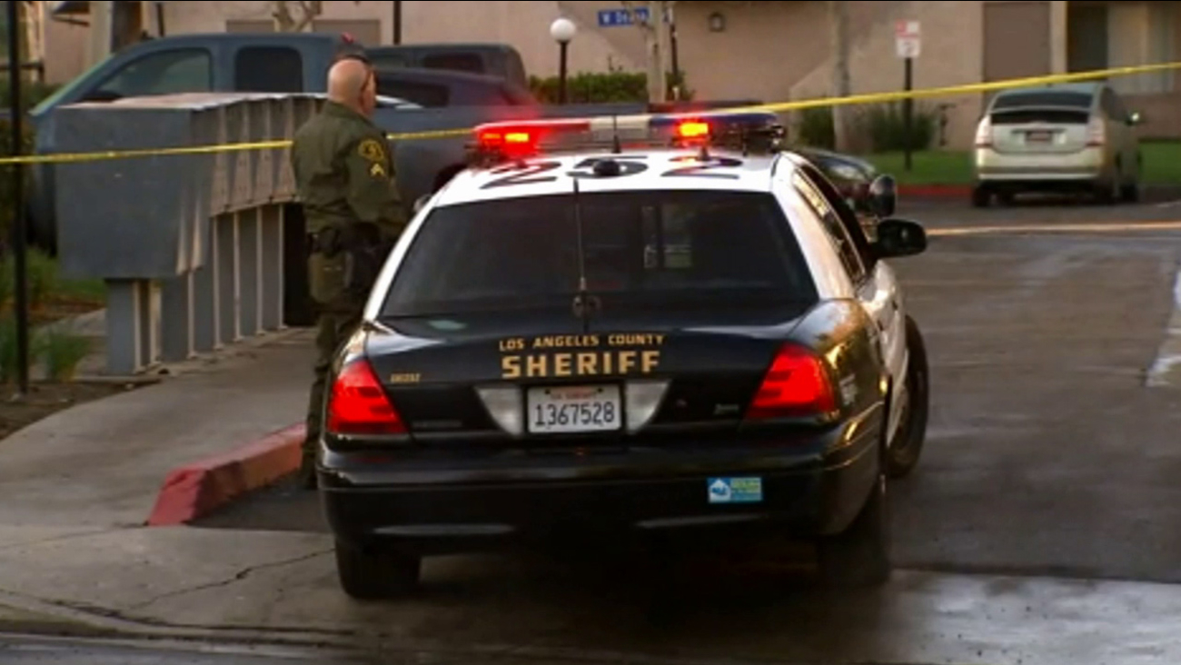 Los Angeles County sheriff's deputies investigate a woman who allegedly shot at two people in Santa Clarita on Sunday, Feb. 8, 2015.