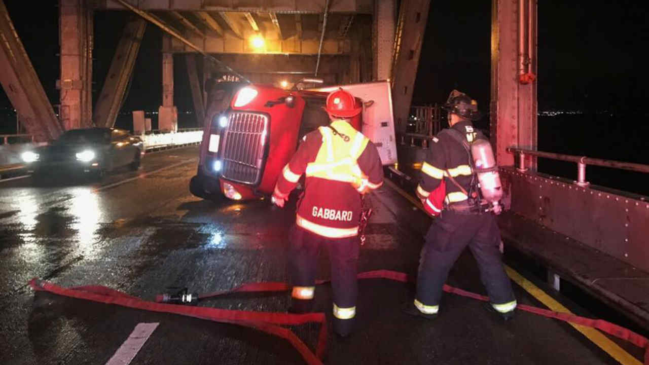 <div class='meta'><div class='origin-logo' data-origin='none'></div><span class='caption-text' data-credit='KGO-TV'>Wind was blamed for this big rig accident on the Richmond-San Rafael Bridge.</span></div>