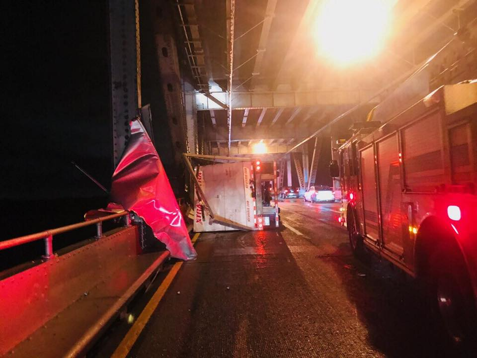<div class='meta'><div class='origin-logo' data-origin='none'></div><span class='caption-text' data-credit='CHP Marin'>A big rig is seen on its side on the Richmond-San Rafael Bridge after wind knocked it over during a storm on Wednesday, Jan. 16, 2019.</span></div>