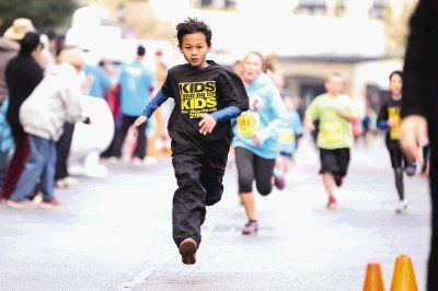 "<div class=""meta image-caption""><div class=""origin-logo origin-image none""><span>none</span></div><span class=""caption-text"">A runner crosses the finish line during the Kids Running for Kids fundraising event Saturday at Market Street in The Woodlands (Michael Minasi/HCN)</span></div>"