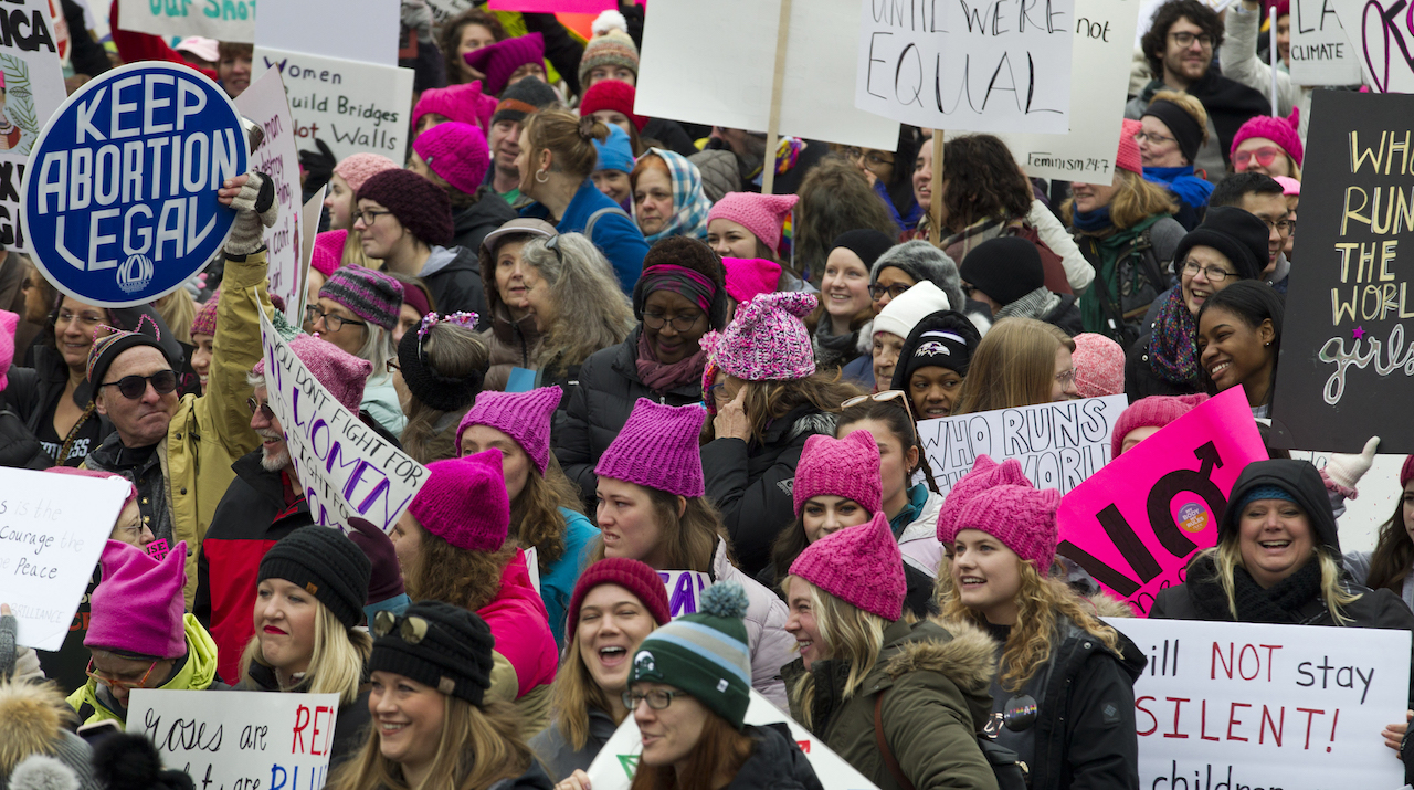 "<div class=""meta image-caption""><div class=""origin-logo origin-image ap""><span>AP</span></div><span class=""caption-text"">Demonstrators hold up their banners as they march on Pennsylvania Avenue during the Women's March in Washington on Saturday, Jan. 19, 2019. (AP Photo/Jose Luis Magana)</span></div>"