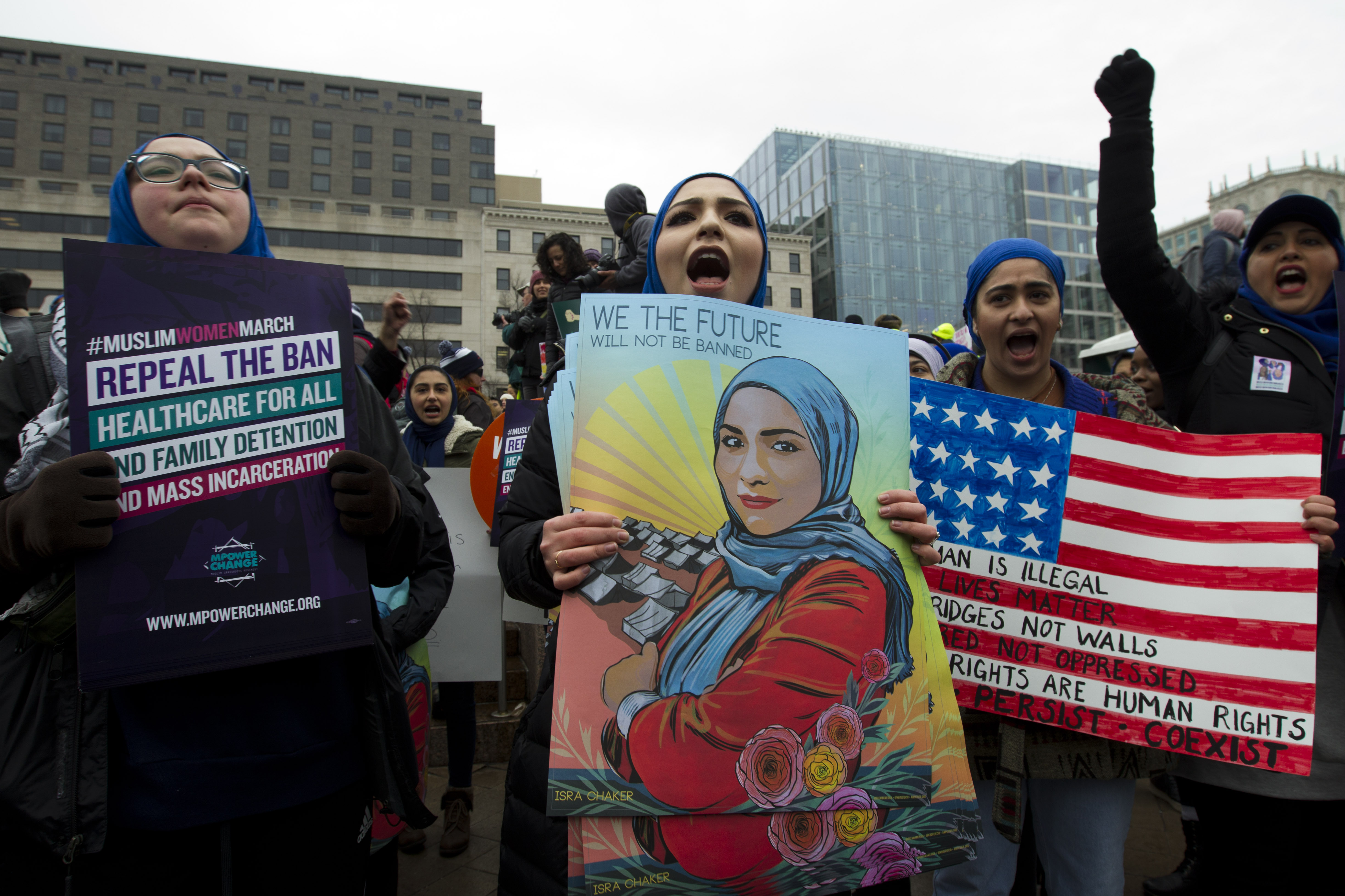<div class='meta'><div class='origin-logo' data-origin='AP'></div><span class='caption-text' data-credit='AP Photo/Jose Luis Magana'>Demonstrators hold signs during the Women's March in Washington on Saturday, Jan. 19, 2019.</span></div>