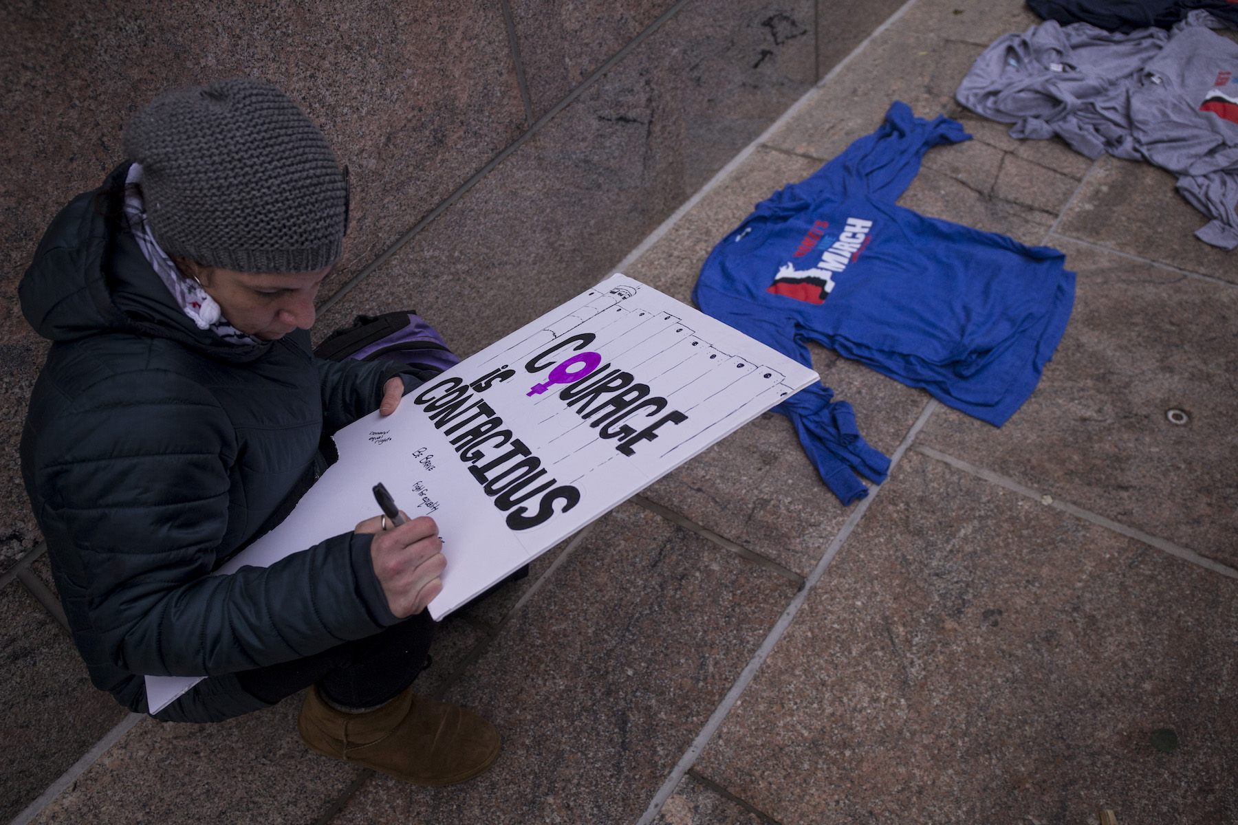 <div class='meta'><div class='origin-logo' data-origin='Creative Content'></div><span class='caption-text' data-credit='Zach Gibson/Getty Images'>A demonstrator prepares a sign during the 2019 Women's March on January 19, 2019, in Washington, DC.</span></div>