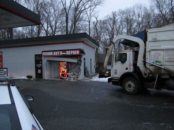 "<div class=""meta image-caption""><div class=""origin-logo origin-image none""><span>none</span></div><span class=""caption-text"">A sanitation truck slid on ice and hit a building at a gas station along Route 1 in South Brunswick.</span></div>"