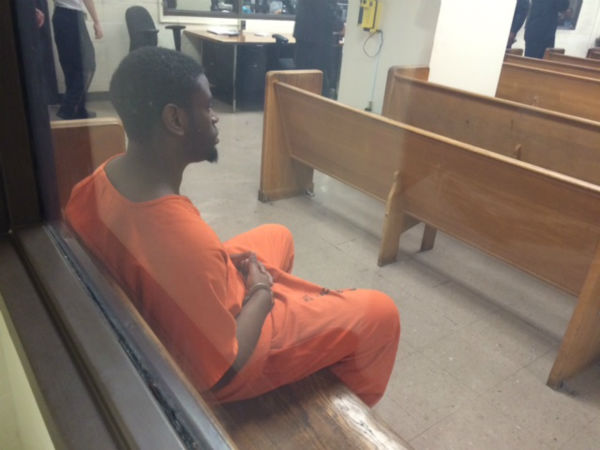 """<div class=""""meta image-caption""""><div class=""""origin-logo origin-image none""""><span>none</span></div><span class=""""caption-text"""">Isaac Tiharihondi sits in a Houston courtroom to hear charges against him</span></div>"""