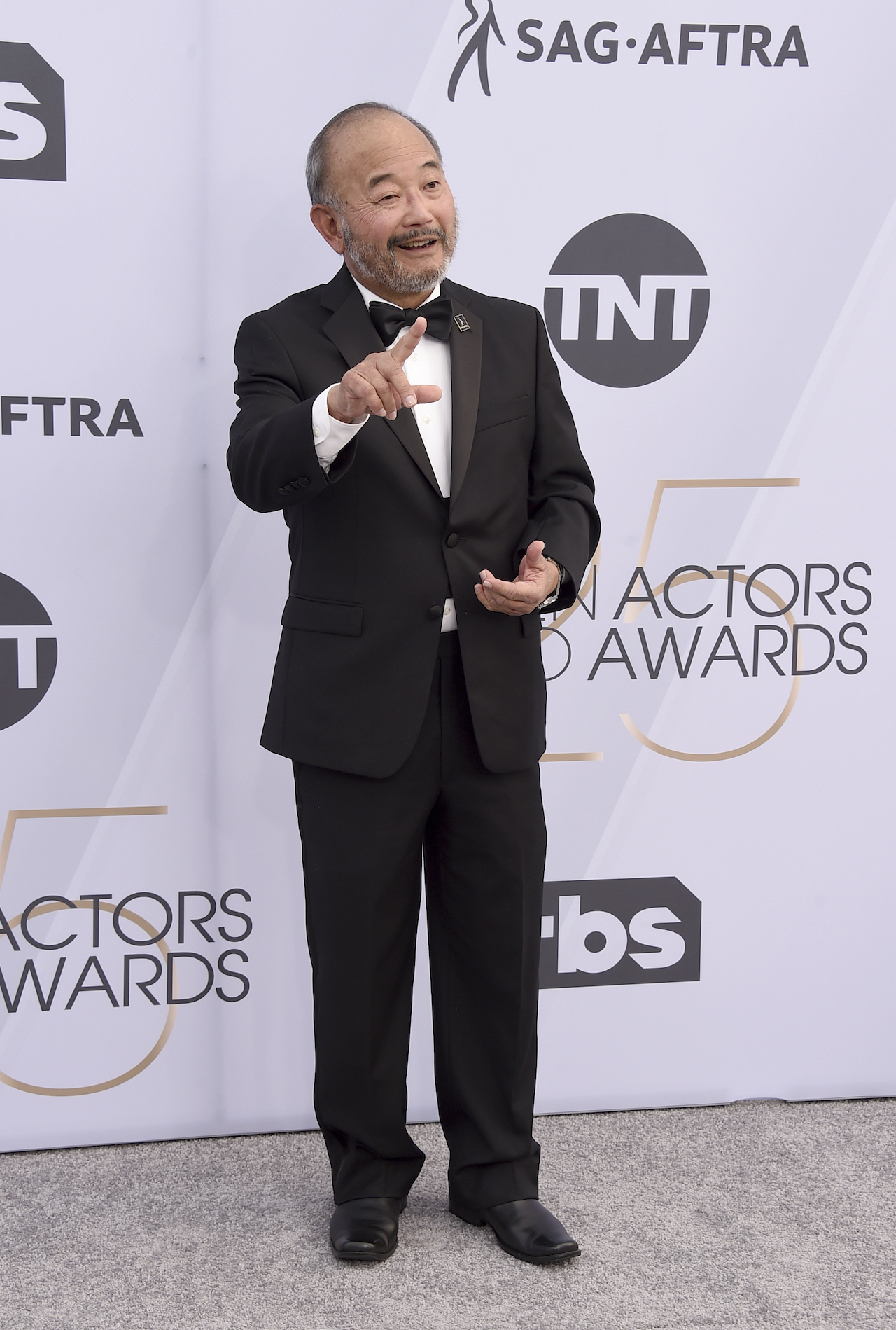 <div class='meta'><div class='origin-logo' data-origin='AP'></div><span class='caption-text' data-credit='Jordan Strauss/Invision/AP'>Clyde Kusatsu arrives at the 25th annual Screen Actors Guild Awards at the Shrine Auditorium & Expo Hall on Sunday, Jan. 27, 2019, in Los Angeles.</span></div>