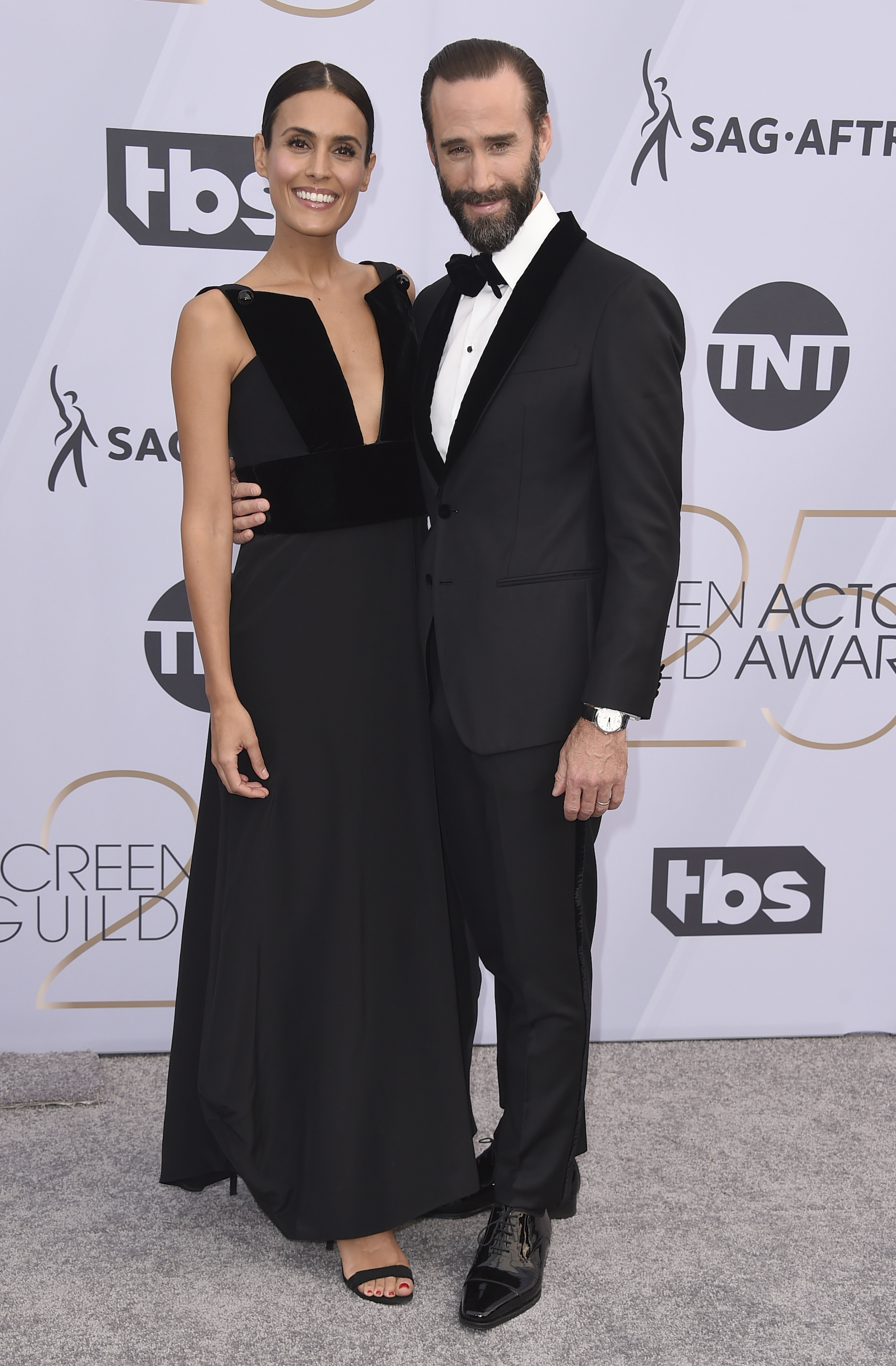 <div class='meta'><div class='origin-logo' data-origin='AP'></div><span class='caption-text' data-credit='Jordan Strauss/Invision/AP'>Maria Dolores Dieguez, left, and Joseph Fiennes arrive at the 25th annual Screen Actors Guild Awards at the Shrine Auditorium & Expo Hall on Sunday, Jan. 27, 2019, in Los Angeles.</span></div>
