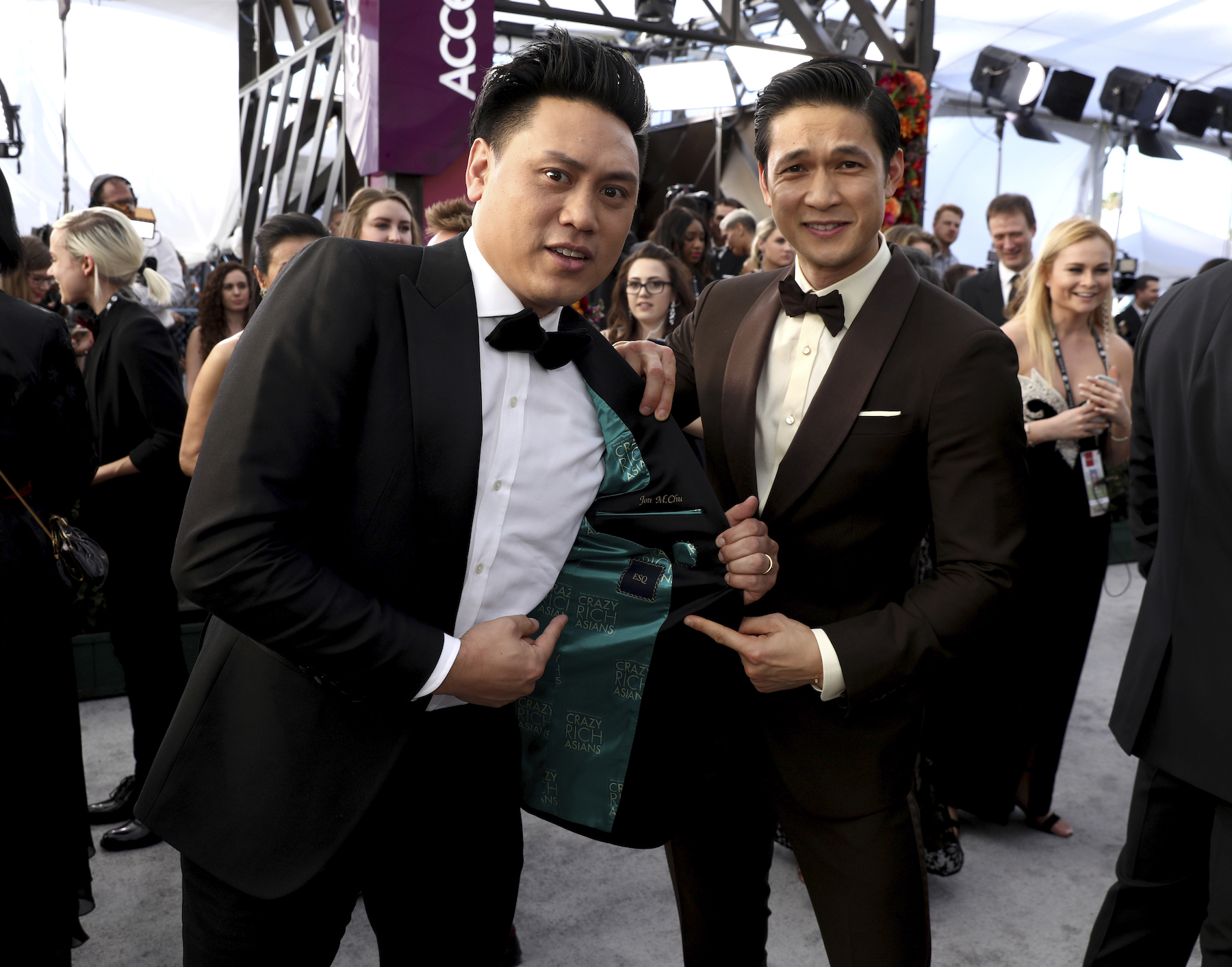 <div class='meta'><div class='origin-logo' data-origin='AP'></div><span class='caption-text' data-credit='Matt Sayles/Invision/AP'>Jon M. Chu, left, and Harry Shum Jr. arrive at the 25th annual Screen Actors Guild Awards at the Shrine Auditorium & Expo Hall on Sunday, Jan. 27, 2019, in Los Angeles.</span></div>