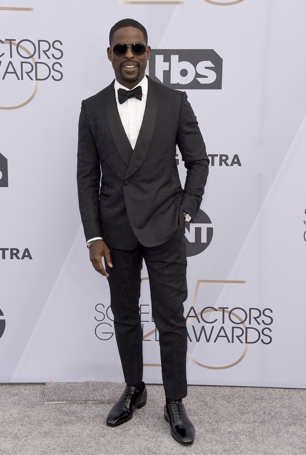 <div class='meta'><div class='origin-logo' data-origin='AP'></div><span class='caption-text' data-credit='Jordan Strauss/Invision/AP'>Sterling K. Brown arrives at the 25th annual Screen Actors Guild Awards at the Shrine Auditorium & Expo Hall on Sunday, Jan. 27, 2019, in Los Angeles.</span></div>