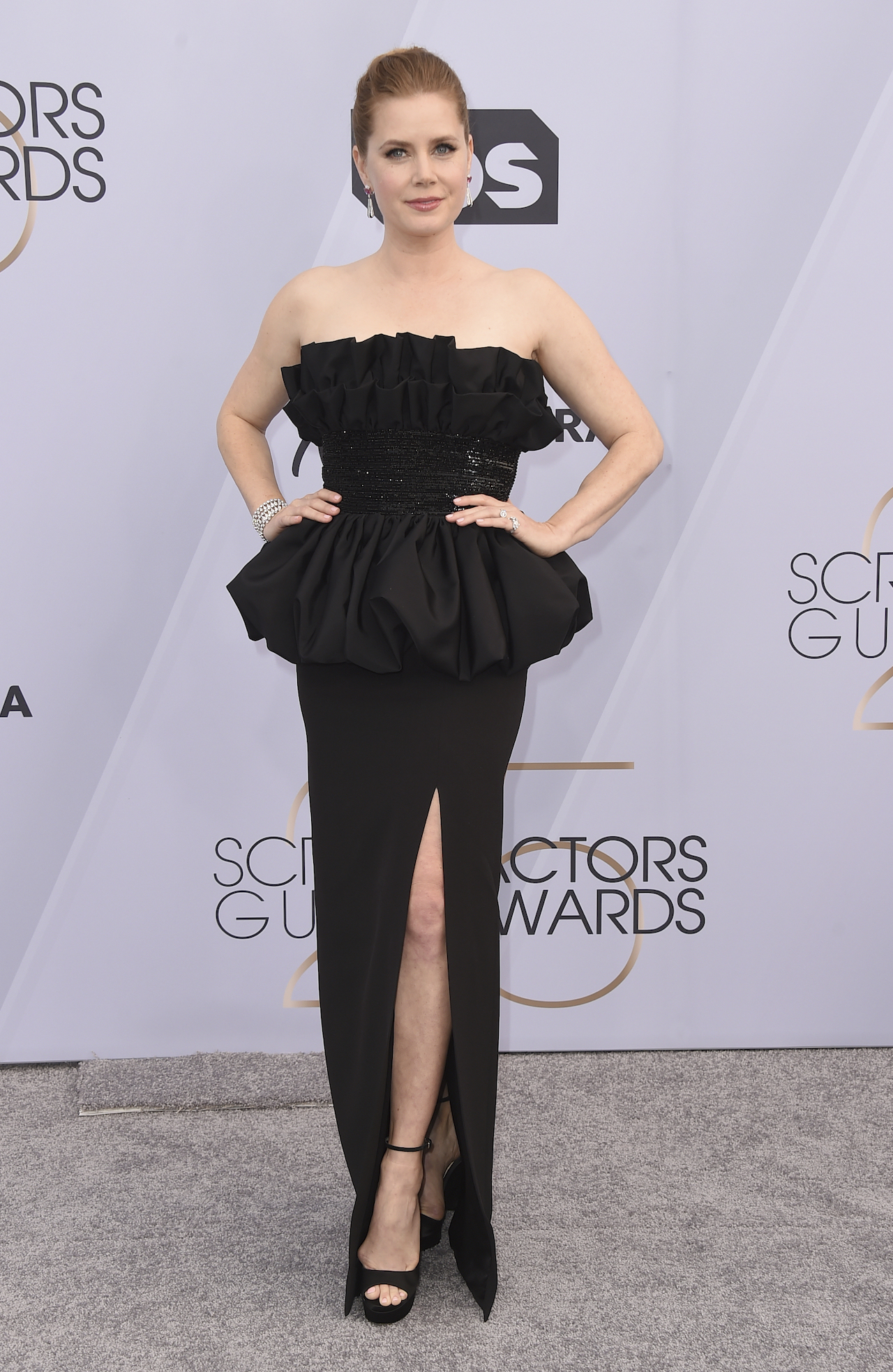<div class='meta'><div class='origin-logo' data-origin='AP'></div><span class='caption-text' data-credit='Jordan Strauss/Invision/AP'>Amy Adams arrives at the 25th annual Screen Actors Guild Awards at the Shrine Auditorium & Expo Hall on Sunday, Jan. 27, 2019, in Los Angeles.</span></div>