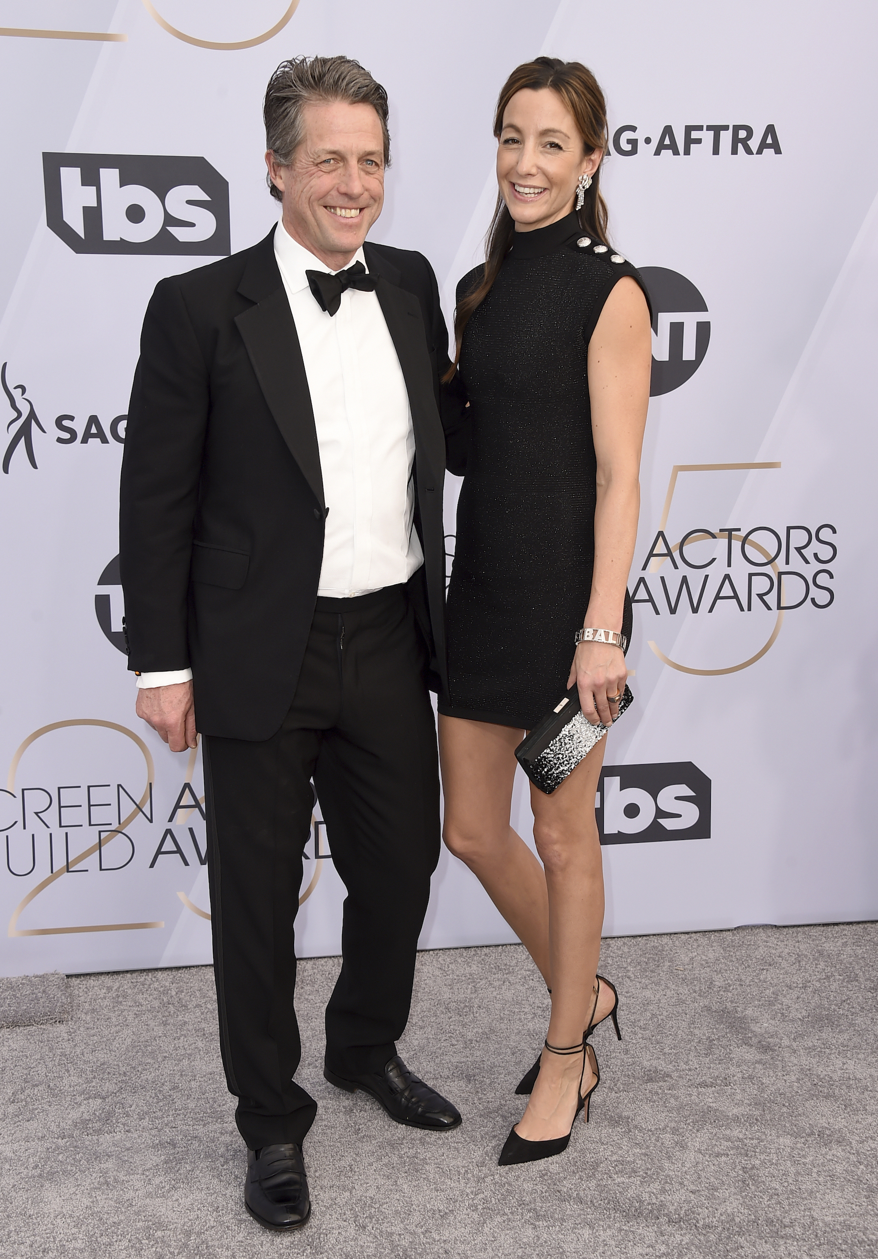 "<div class=""meta image-caption""><div class=""origin-logo origin-image ap""><span>AP</span></div><span class=""caption-text"">Hugh Grant, left, and Anna Elisabet Eberstein arrive at the 25th annual Screen Actors Guild Awards at the Shrine Auditorium & Expo Hall on Sunday, Jan. 27, 2019, in Los Angeles. (Jordan Strauss/Invision/AP)</span></div>"