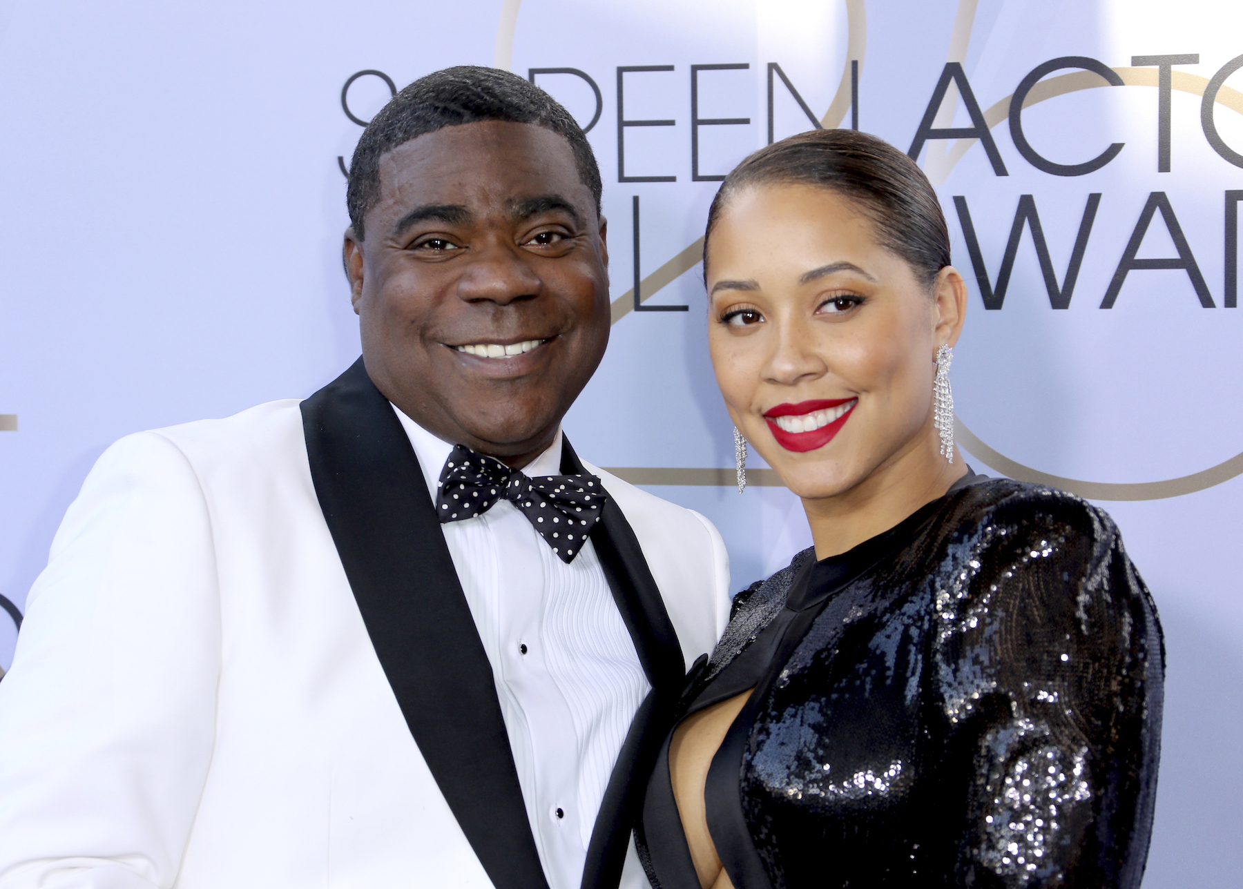 <div class='meta'><div class='origin-logo' data-origin='AP'></div><span class='caption-text' data-credit='Willy Sanjuan/Invision/AP'>Tracy Morgan, left, and Megan Wollover arrive at the 25th annual Screen Actors Guild Awards at the Shrine Auditorium & Expo Hall on Sunday, Jan. 27, 2019, in Los Angeles.</span></div>