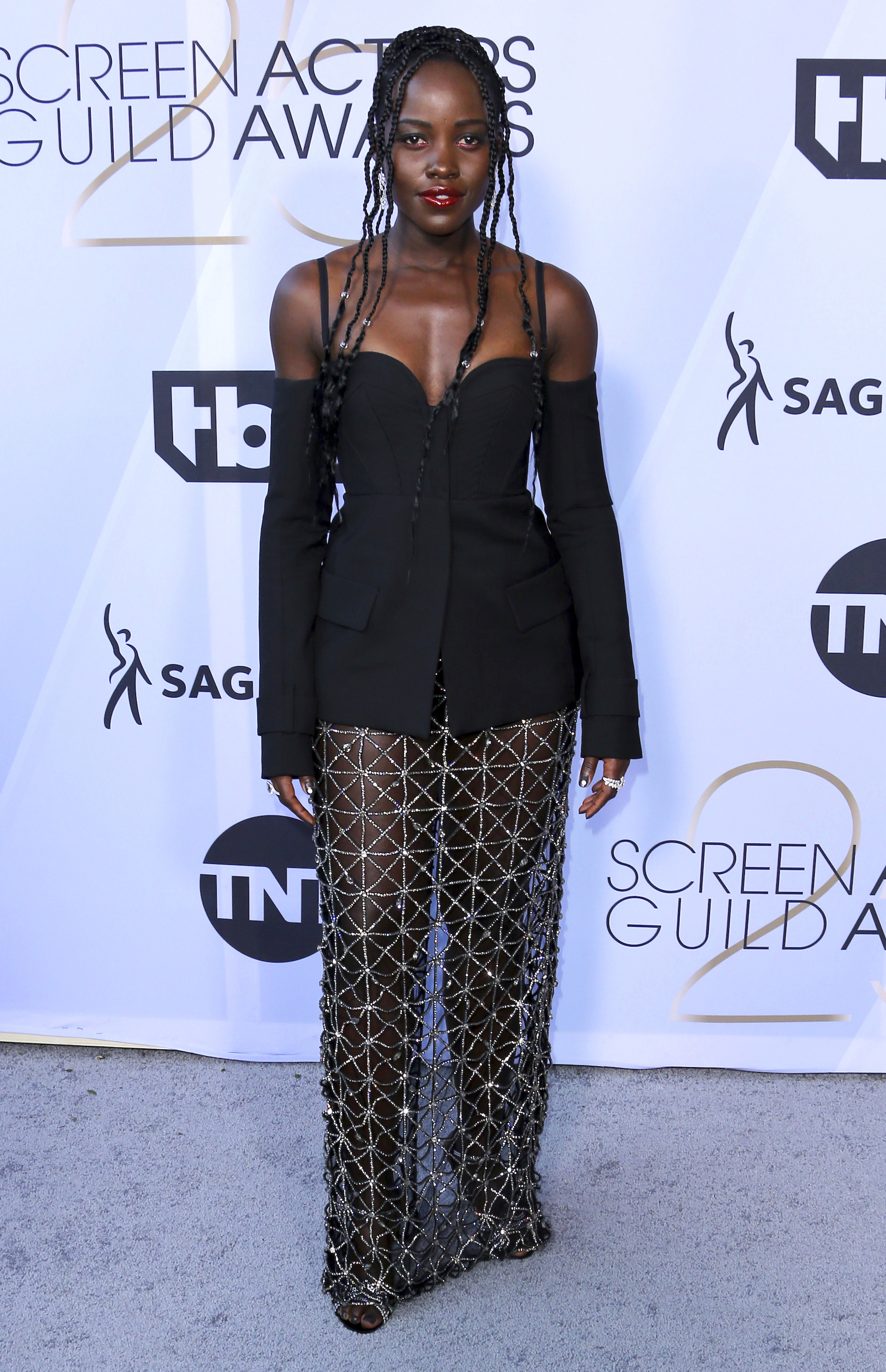 <div class='meta'><div class='origin-logo' data-origin='AP'></div><span class='caption-text' data-credit='Willy Sanjuan/Invision/AP'>Lupita Nyong'o arrives at the 25th annual Screen Actors Guild Awards at the Shrine Auditorium & Expo Hall on Sunday, Jan. 27, 2019, in Los Angeles.</span></div>