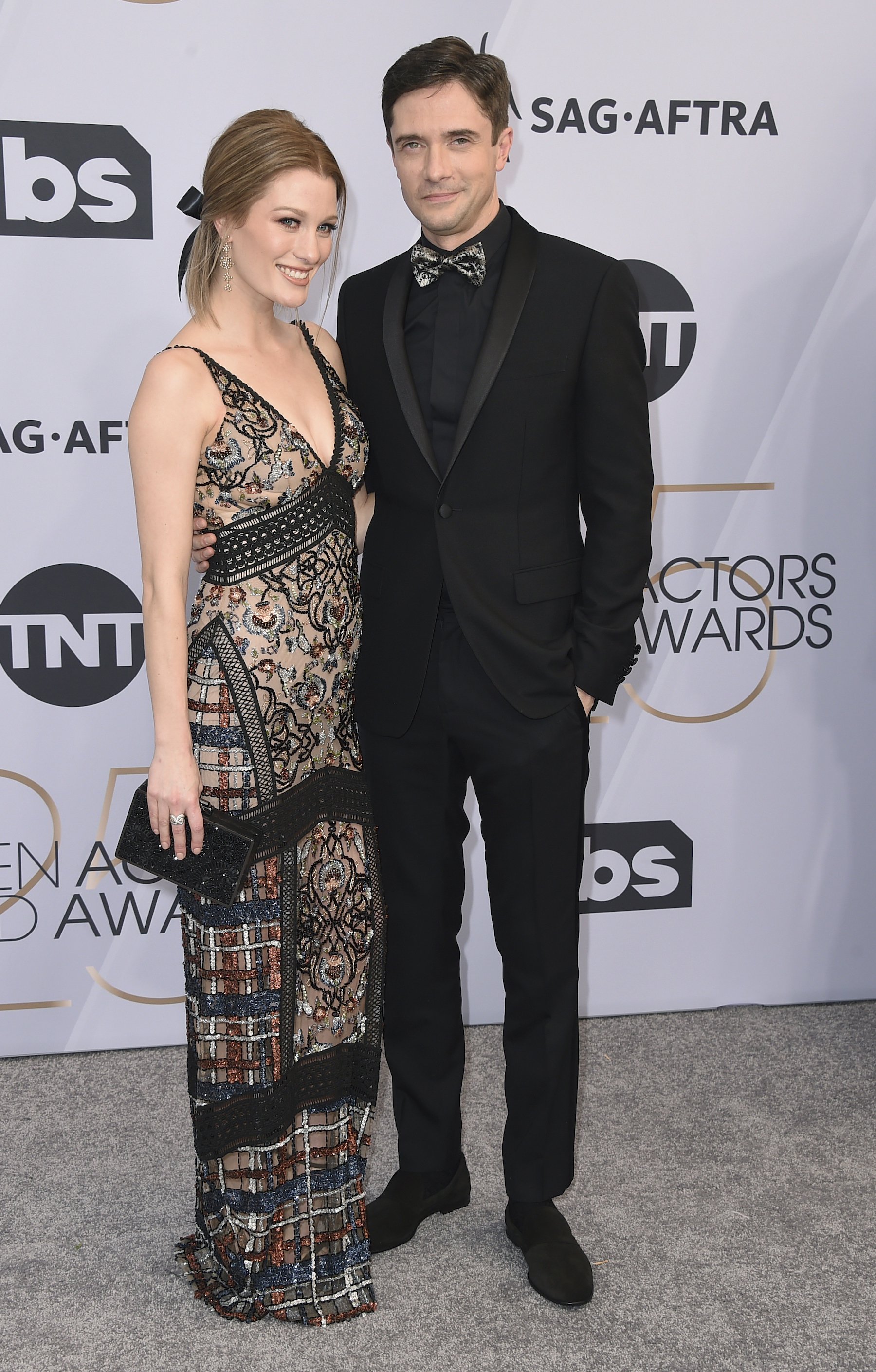 "<div class=""meta image-caption""><div class=""origin-logo origin-image ap""><span>AP</span></div><span class=""caption-text"">Ashley Hinshaw, left, and Topher Grace arrive at the 25th annual Screen Actors Guild Awards at the Shrine Auditorium & Expo Hall on Sunday, Jan. 27, 2019, in Los Angeles. (Jordan Strauss/Invision/AP)</span></div>"