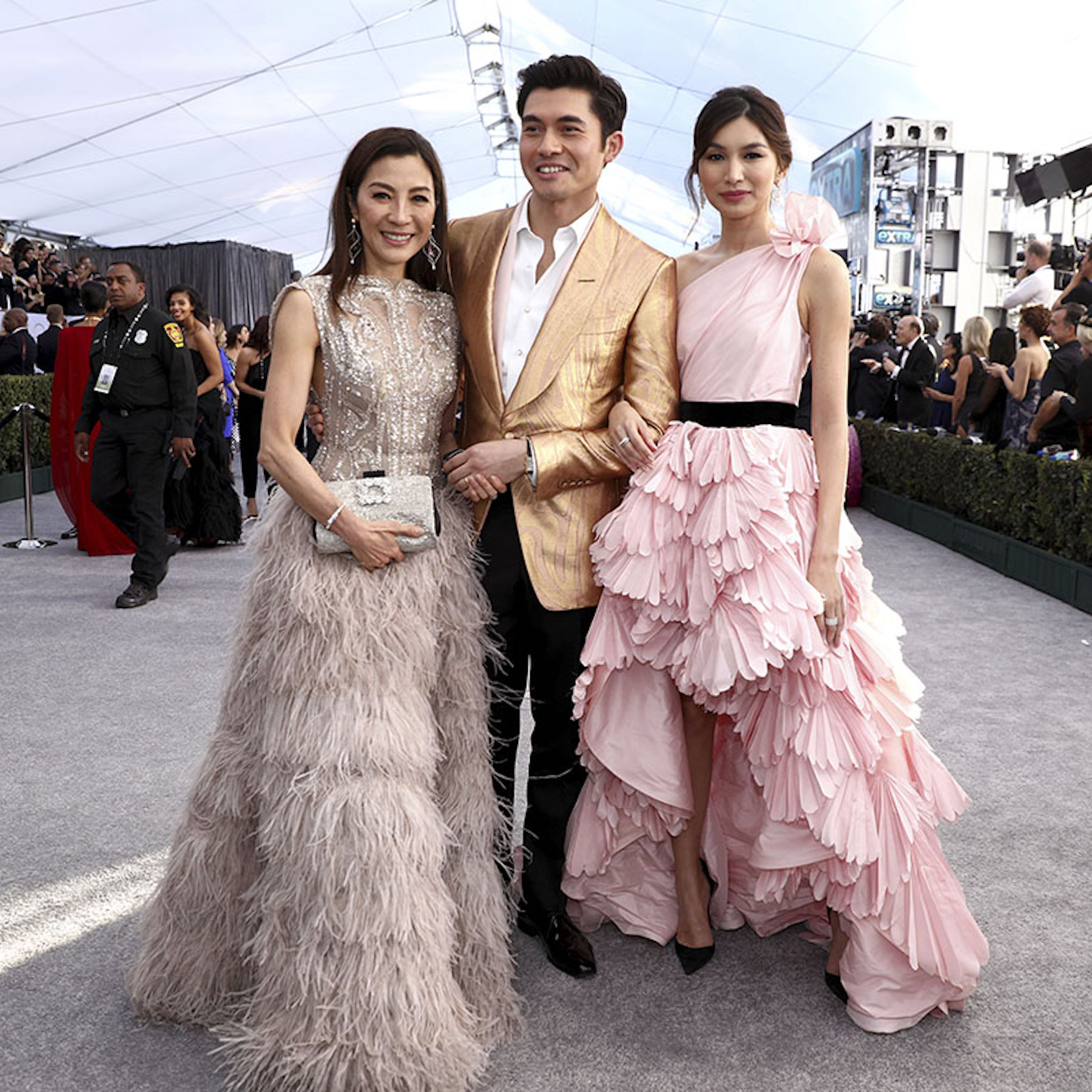 <div class='meta'><div class='origin-logo' data-origin='AP'></div><span class='caption-text' data-credit='Matt Sayles/Invision/AP'>Michelle Yeoh, from left, Henry Golding and Gemma Chan arrive at the 25th annual Screen Actors Guild Awards at the Shrine Auditorium & Expo Hall on Sunday, Jan. 27, 2019.</span></div>