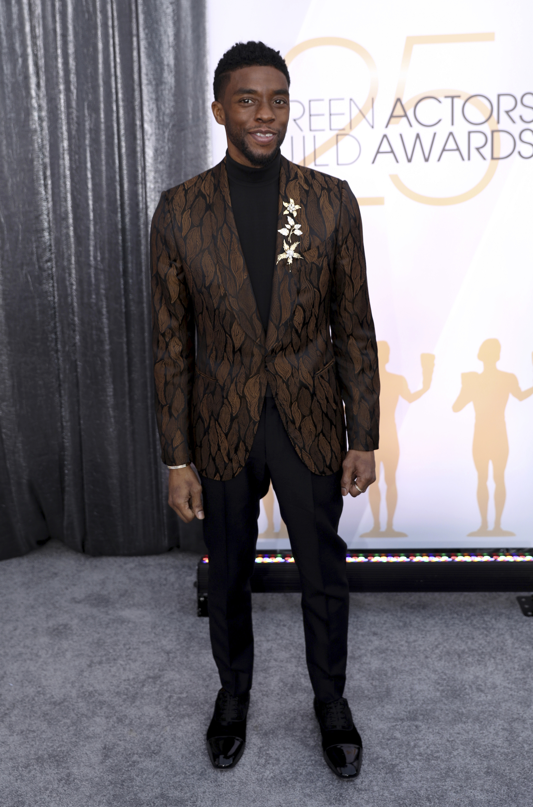 <div class='meta'><div class='origin-logo' data-origin='AP'></div><span class='caption-text' data-credit='Matt Sayles/Invision/AP'>Chadwick Boseman arrives at the 25th annual Screen Actors Guild Awards at the Shrine Auditorium & Expo Hall on Sunday, Jan. 27, 2019, in Los Angeles.</span></div>