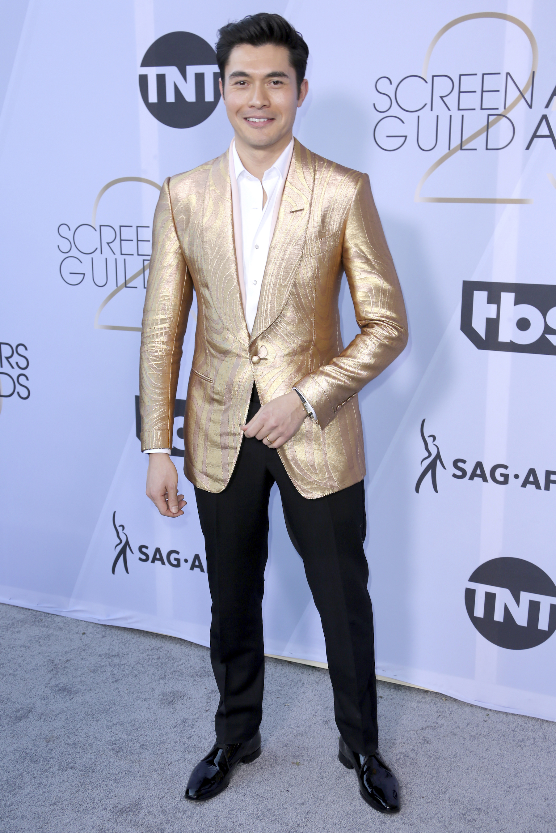 <div class='meta'><div class='origin-logo' data-origin='AP'></div><span class='caption-text' data-credit='Willy Sanjuan/Invision/AP'>Henry Golding arrives at the 25th annual Screen Actors Guild Awards at the Shrine Auditorium & Expo Hall on Sunday, Jan. 27, 2019, in Los Angeles.</span></div>