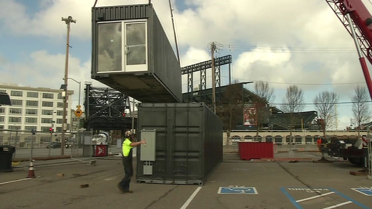 refurbished shipping container being lifted into the air