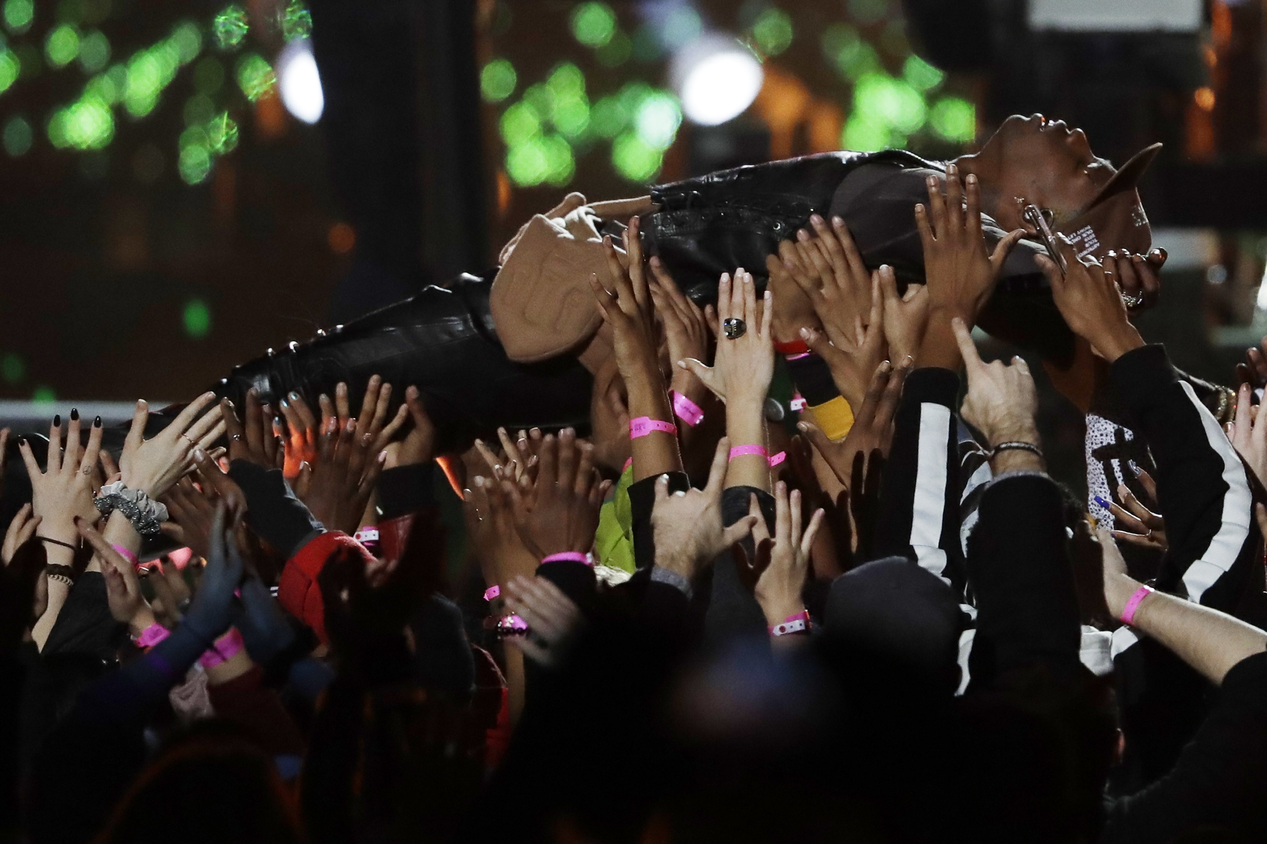 "<div class=""meta image-caption""><div class=""origin-logo origin-image ap""><span>AP</span></div><span class=""caption-text"">Travis Scott is carried by the crowd during the halftime show of the NFL Super Bowl 53 football game between the Los Angeles Rams and the New England Patriots. (AP Photo/Jeff Roberson)</span></div>"