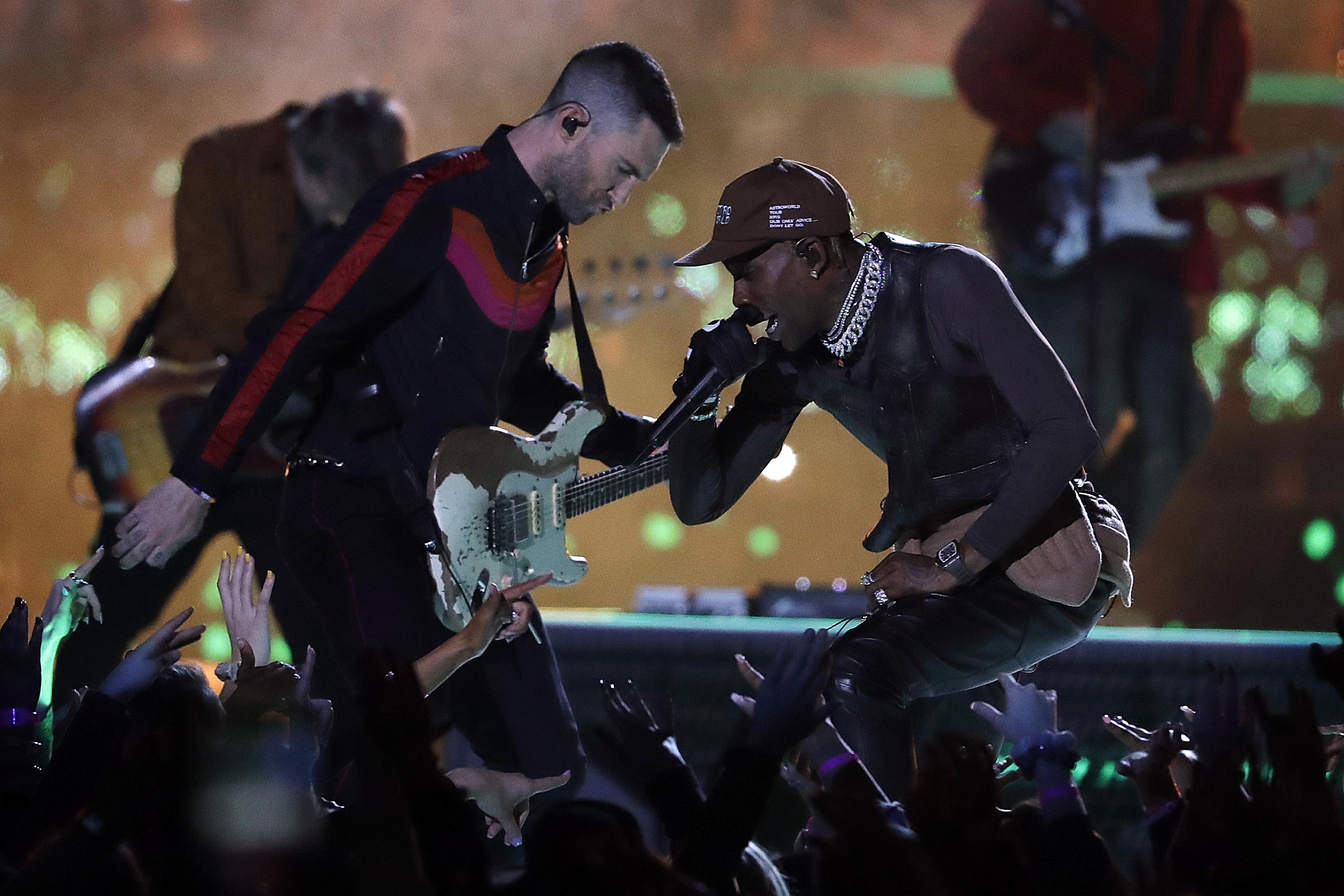 "<div class=""meta image-caption""><div class=""origin-logo origin-image ap""><span>AP</span></div><span class=""caption-text"">Adam Levine of Maroon 5, left, and Travis Scott perform during halftime of the NFL Super Bowl 53 football game between the Los Angeles Rams and the New England Patriots. (AP Photo/Jeff Roberson)</span></div>"