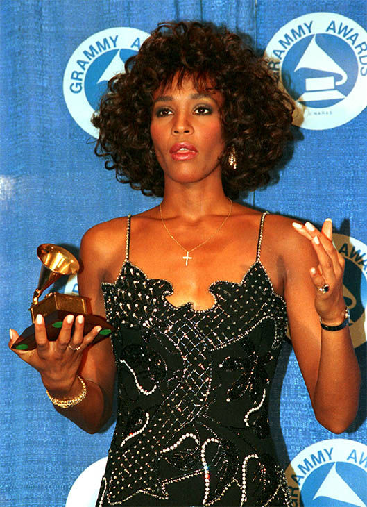 """<div class=""""meta image-caption""""><div class=""""origin-logo origin-image none""""><span>none</span></div><span class=""""caption-text"""">Mar. 1988: poses with her Grammy at the annual Grammy Awards presentation after winning best female vocalist for her single """"I Wanna Dance with Somebody."""" (Photo/AP Photo)</span></div>"""