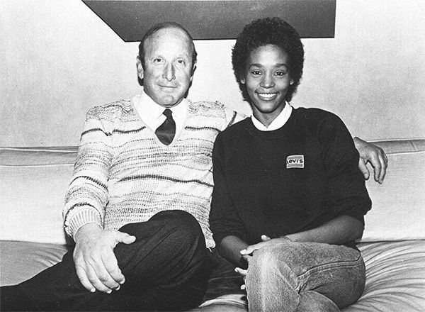 """<div class=""""meta image-caption""""><div class=""""origin-logo origin-image none""""><span>none</span></div><span class=""""caption-text"""">1983: Houston with music producer Clive Davis shortly after signing a contract with Arista Records. (Photo/AP Photo)</span></div>"""