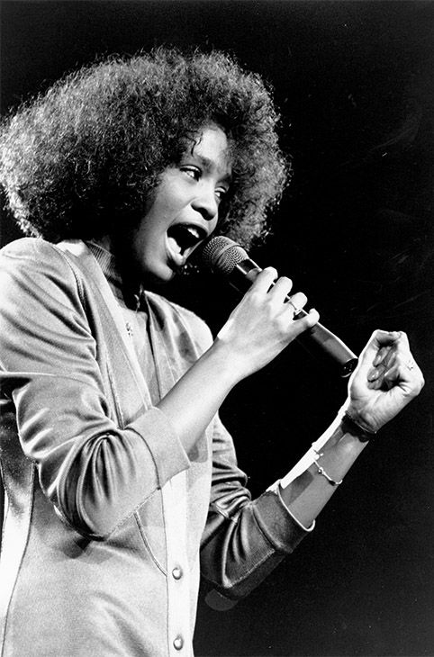 """<div class=""""meta image-caption""""><div class=""""origin-logo origin-image none""""><span>none</span></div><span class=""""caption-text"""">May 1986: Houston belts out a song during her segment of a benefit concert at Boston Garden. (Photo/AP Photo)</span></div>"""