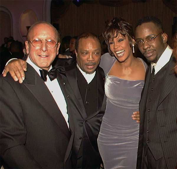 """<div class=""""meta image-caption""""><div class=""""origin-logo origin-image none""""><span>none</span></div><span class=""""caption-text"""">Feb 1996: Arista Records head Clive Davis, left, at his 10th annual pre-Grammy party with, from left, Quincy Jones, Whitney Houston, and Bobby Brown. (Photo/AP Photo)</span></div>"""