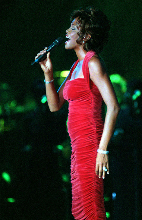 """<div class=""""meta image-caption""""><div class=""""origin-logo origin-image none""""><span>none</span></div><span class=""""caption-text"""">Sept. 1996: Houston performs for the Black Entertainment Televisions's awards gala, receiving BET's second annual Walk of Fame award. (Photo/AP Photo)</span></div>"""