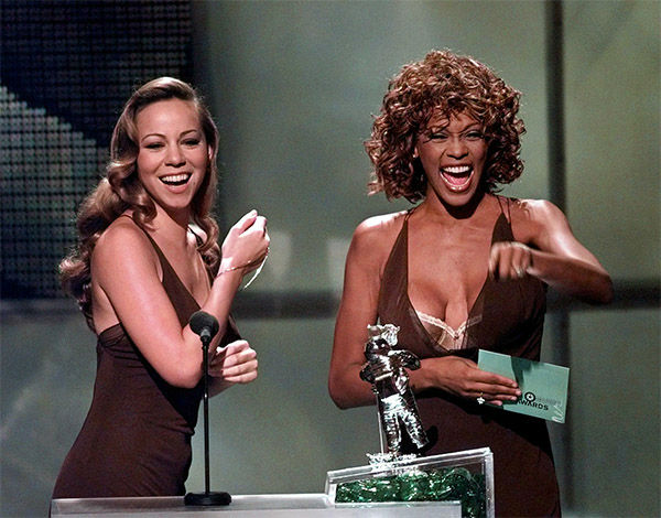 """<div class=""""meta image-caption""""><div class=""""origin-logo origin-image none""""><span>none</span></div><span class=""""caption-text"""">Sept. 1998: Mariah Carey, left, and Whitney Houston present the award for Best Male Video during the MTV Video Music Awards. (Photo/AP Photo)</span></div>"""