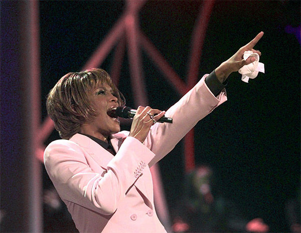 """<div class=""""meta image-caption""""><div class=""""origin-logo origin-image none""""><span>none</span></div><span class=""""caption-text"""">July 1999: Houston performs """"Until You Come Back To Me"""" during the 26th annual American Music Awards at the Shrine Auditorium in Los Angeles (Photo/AP Photo)</span></div>"""
