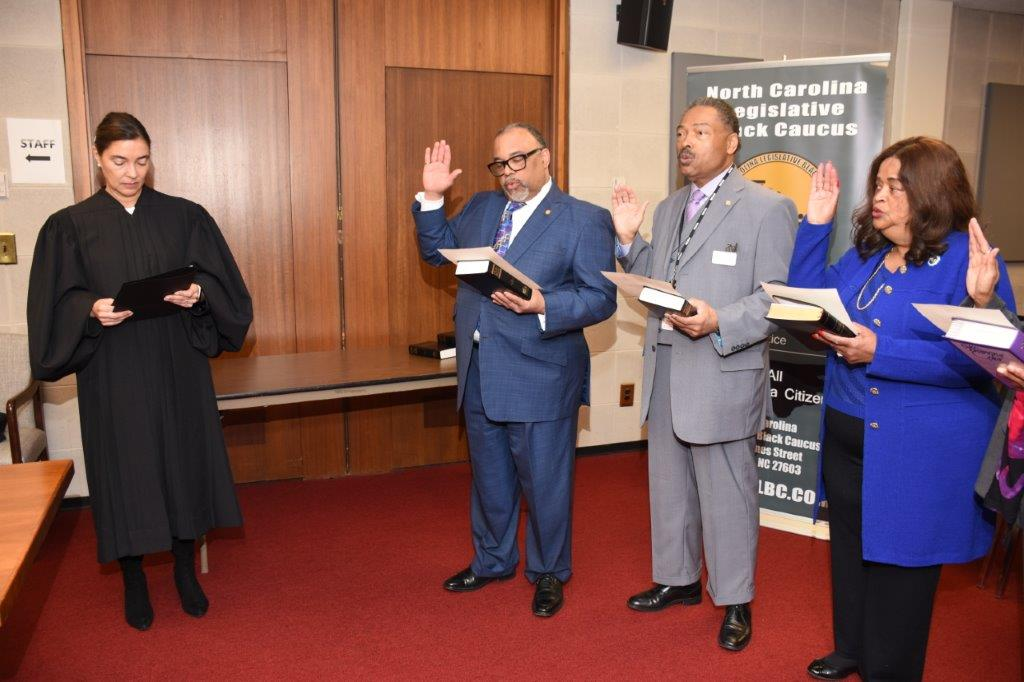 "<div class=""meta image-caption""><div class=""origin-logo origin-image none""><span>none</span></div><span class=""caption-text"">Judge Anita Earls swears in the new chair, NC Senator Reverend Paul Lowe; First Vice Chair, Rep. Kelly Alexander Jr.; and Second Vice Chair, Rep. Jean Farmer-Butterfield.</span></div>"