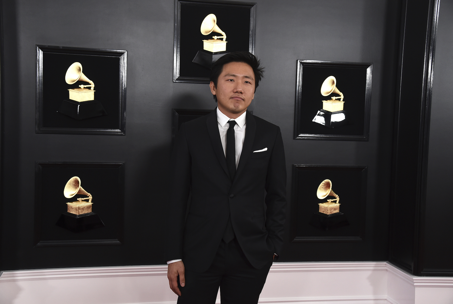 <div class='meta'><div class='origin-logo' data-origin='AP'></div><span class='caption-text' data-credit='Jordan Strauss/Invision/AP'>Hiro Murai arrives at the 61st annual Grammy Awards at the Staples Center on Sunday, Feb. 10, 2019, in Los Angeles.</span></div>