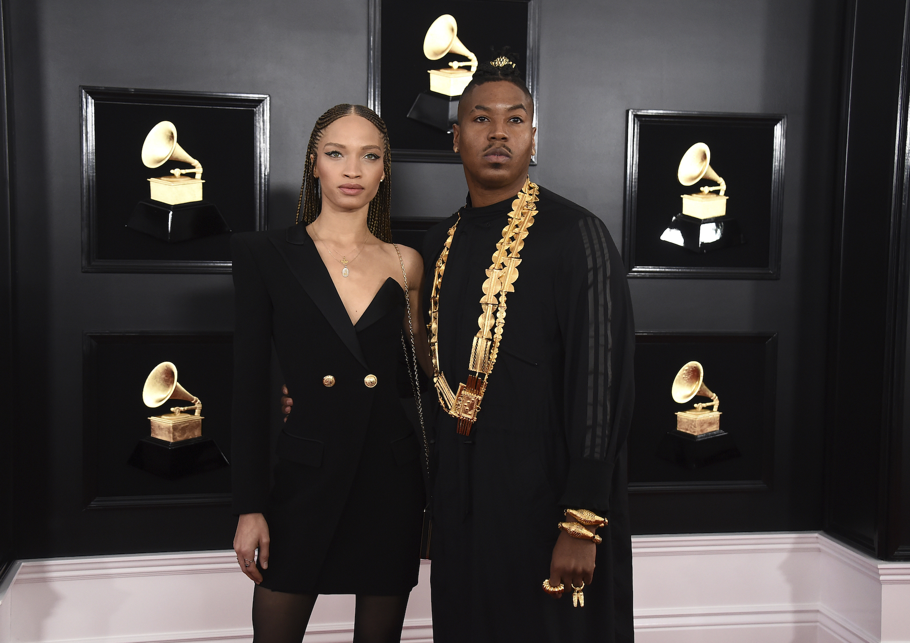<div class='meta'><div class='origin-logo' data-origin='AP'></div><span class='caption-text' data-credit='Jordan Strauss/Invision/AP'>Devan Mayfield, left, and Christian Scott aTunde Adjuah arrive at the 61st annual Grammy Awards at the Staples Center on Sunday, Feb. 10, 2019, in Los Angeles.</span></div>