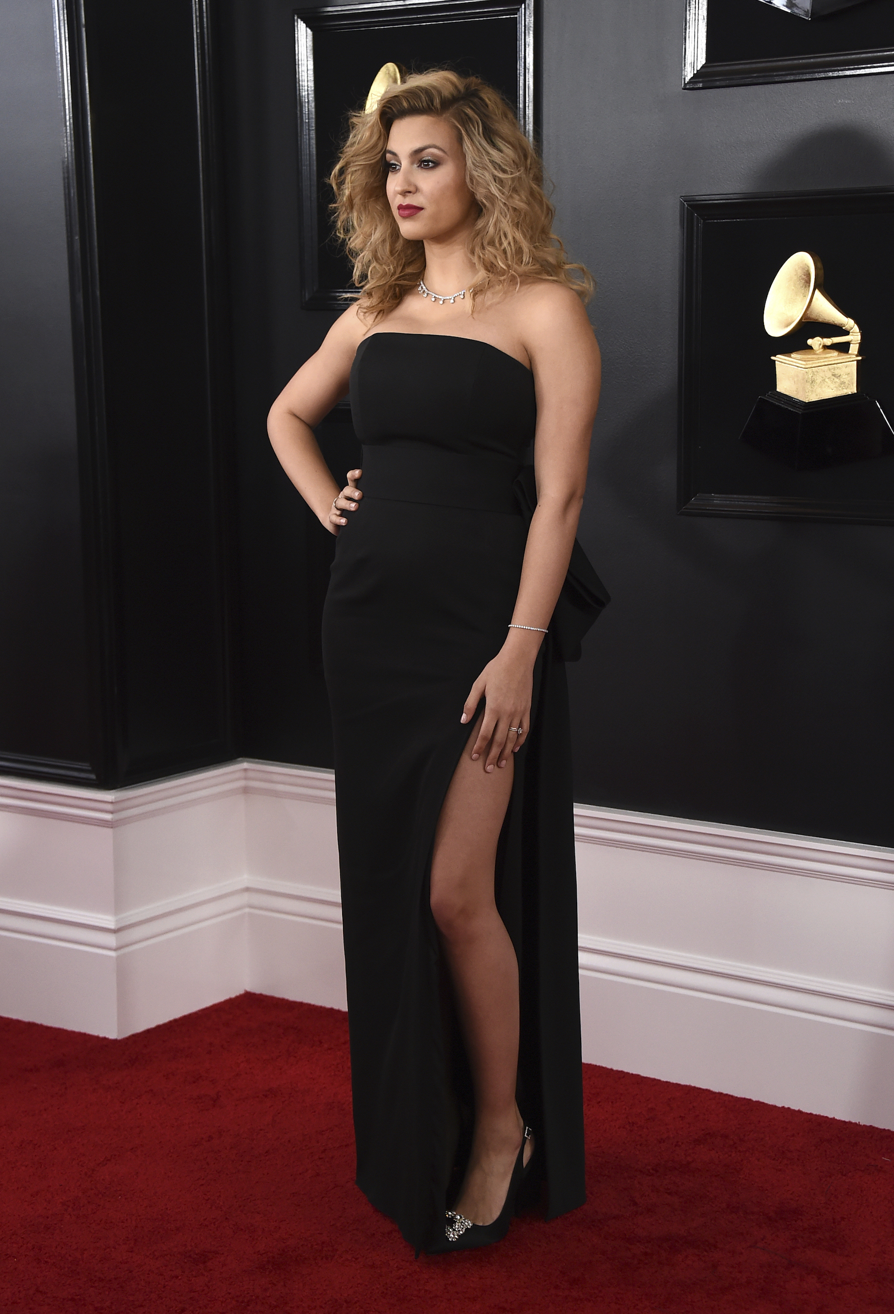 "<div class=""meta image-caption""><div class=""origin-logo origin-image ap""><span>AP</span></div><span class=""caption-text"">Tori Kelly arrives at the 61st annual Grammy Awards at the Staples Center on Sunday, Feb. 10, 2019, in Los Angeles. (Jordan Strauss/Invision/AP)</span></div>"