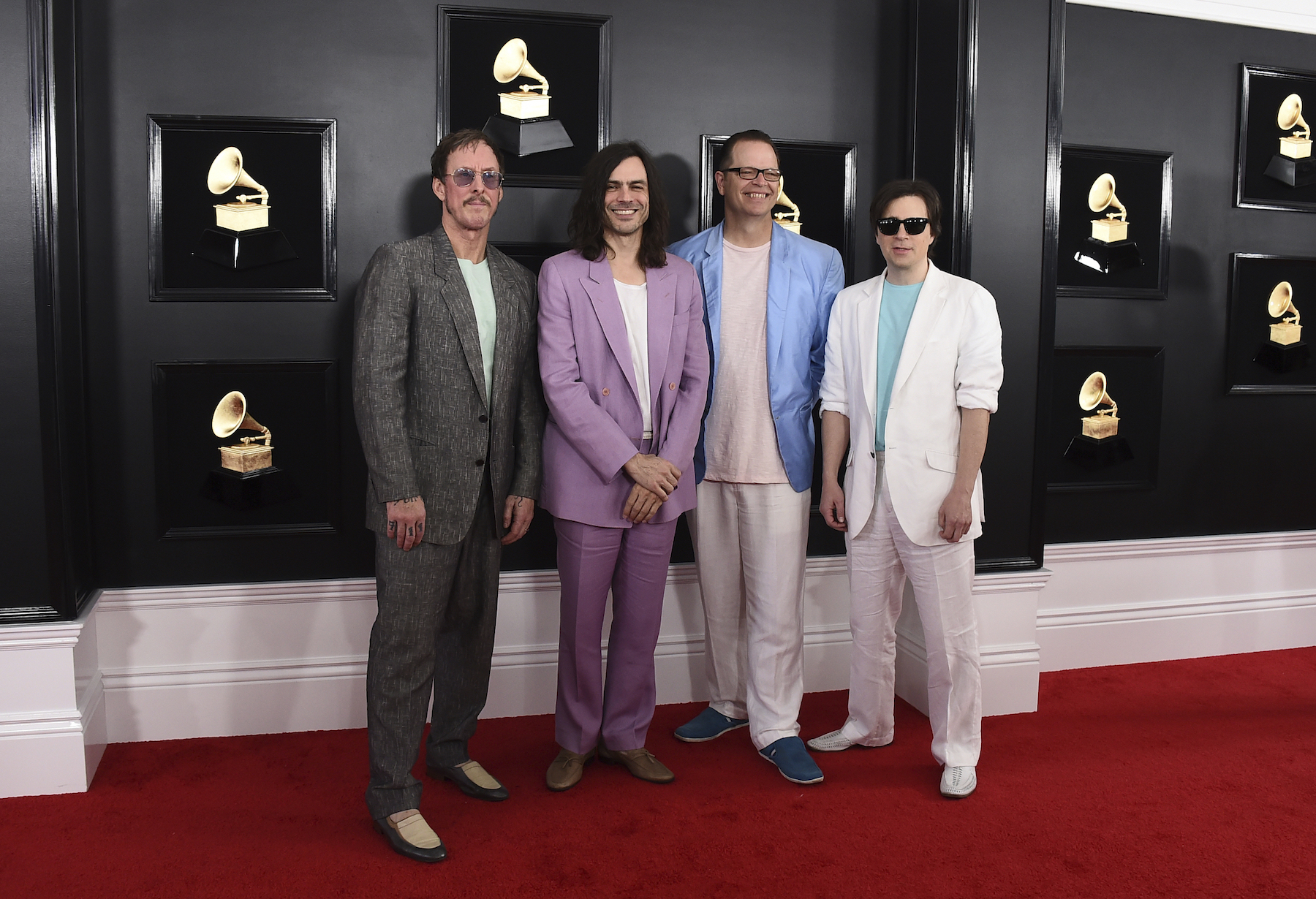 <div class='meta'><div class='origin-logo' data-origin='AP'></div><span class='caption-text' data-credit='Jordan Strauss/Invision/AP'>Rivers Cuomo, from left, Brian Bell, Patrick Wilson, and Scott Shriner of Weezer arrive at the 61st annual Grammy Awards at the Staples Center on Sunday, Feb. 10, 2019.</span></div>