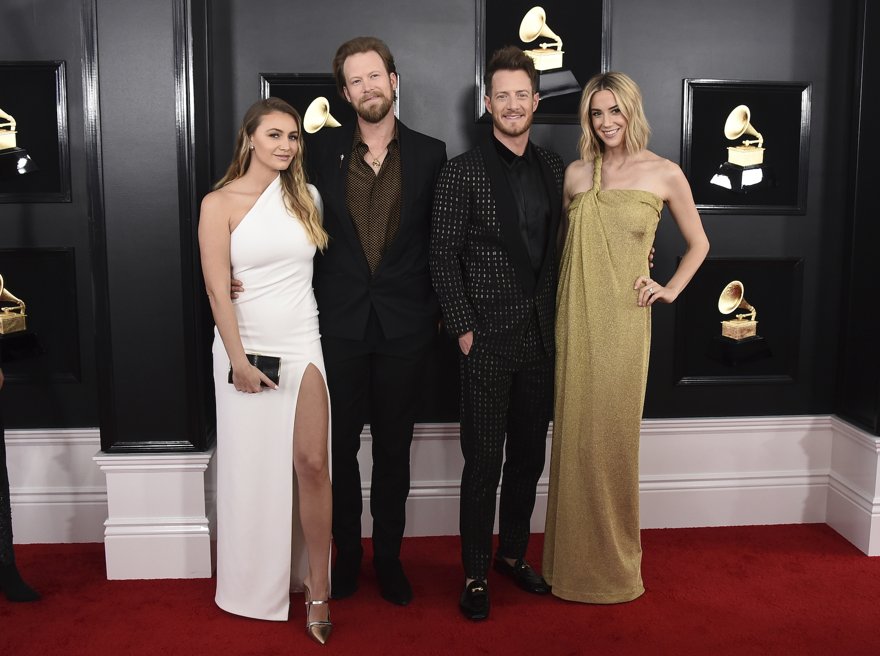 "<div class=""meta image-caption""><div class=""origin-logo origin-image ap""><span>AP</span></div><span class=""caption-text"">Brittney Marie Cole, from left, Brian Kelley, Tyler Hubbard, and Hayley Stommel arrive at the 61st annual Grammy Awards at the Staples Center on Sunday, Feb. 10, 2019. (Jordan Strauss/Invision/AP)</span></div>"