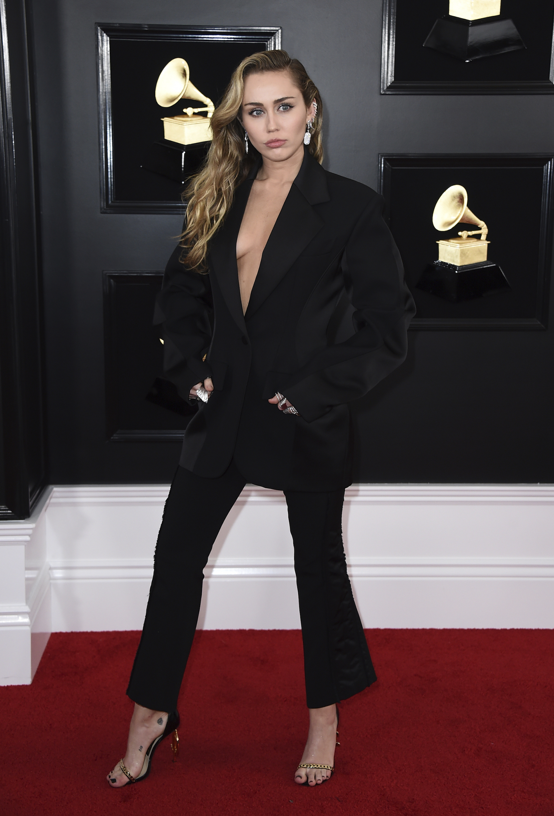 "<div class=""meta image-caption""><div class=""origin-logo origin-image ap""><span>AP</span></div><span class=""caption-text"">Miley Cyrus arrives at the 61st annual Grammy Awards at the Staples Center on Sunday, Feb. 10, 2019, in Los Angeles. (Jordan Strauss/Invision/AP)</span></div>"