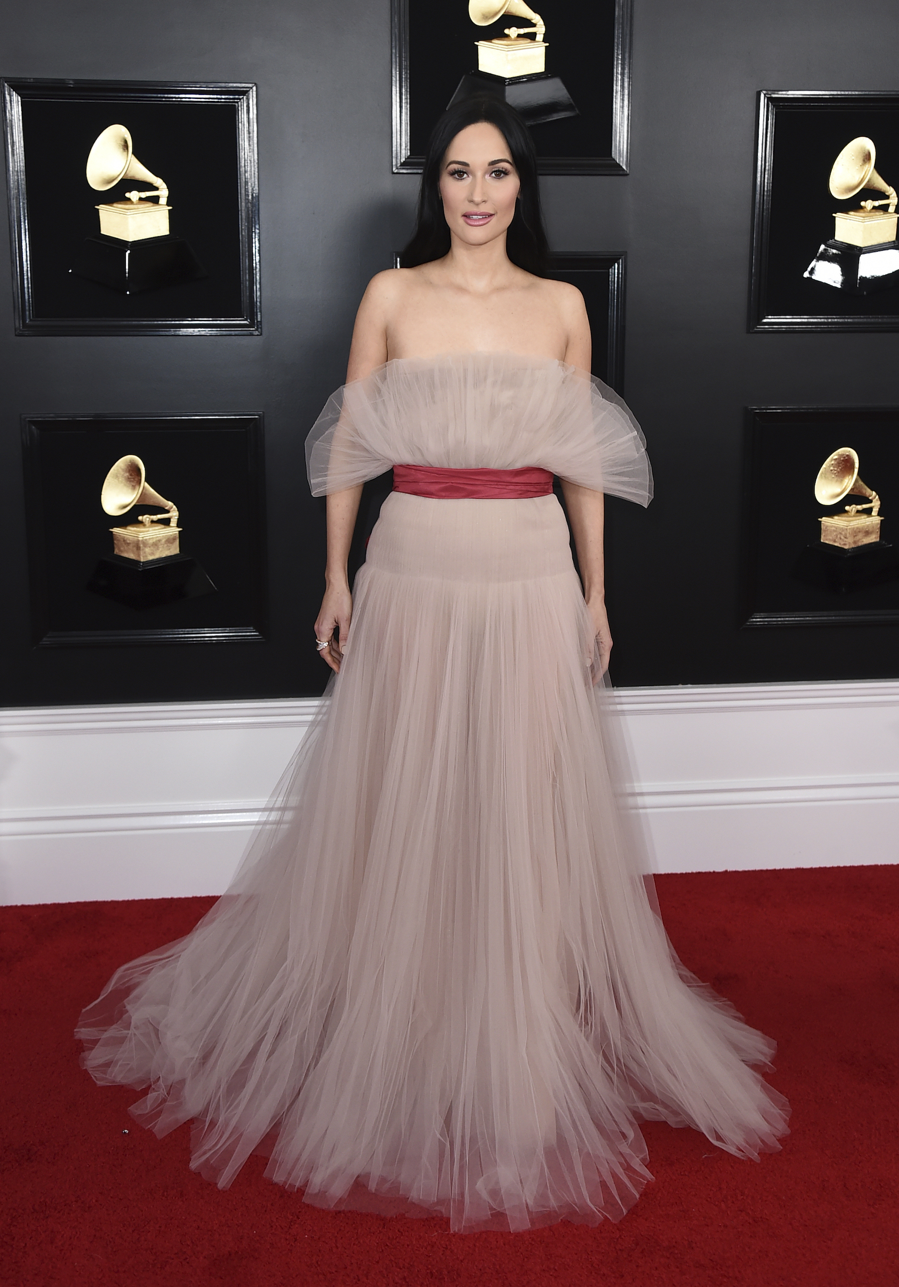 <div class='meta'><div class='origin-logo' data-origin='AP'></div><span class='caption-text' data-credit='Jordan Strauss/Invision/AP'>Kacey Musgraves arrives at the 61st annual Grammy Awards at the Staples Center on Sunday, Feb. 10, 2019, in Los Angeles.</span></div>