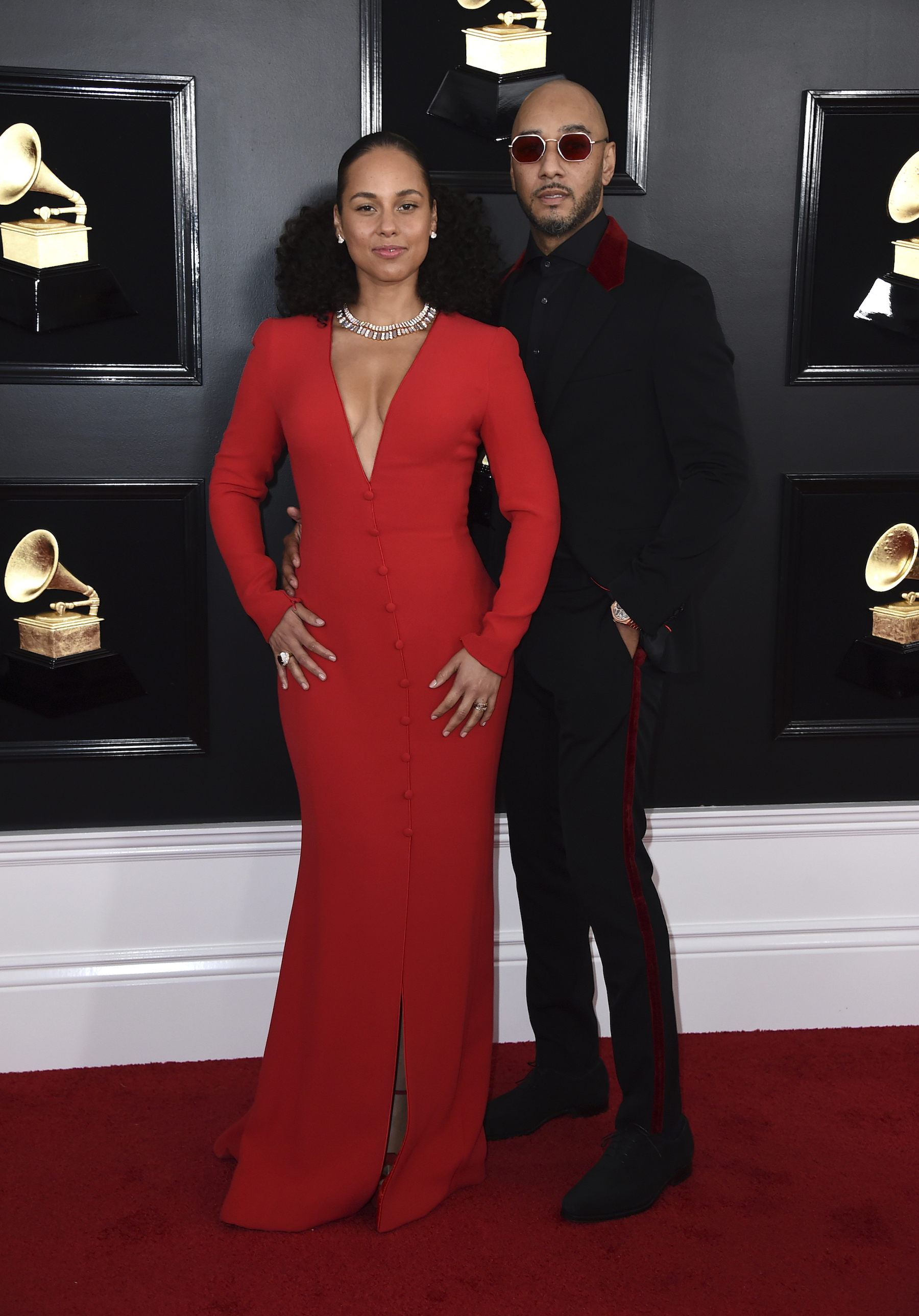 <div class='meta'><div class='origin-logo' data-origin='AP'></div><span class='caption-text' data-credit='Jordan Strauss/Invision/AP'>Alicia Keys, left, and Swizz Beatz arrive at the 61st annual Grammy Awards at the Staples Center on Sunday, Feb. 10, 2019, in Los Angeles.</span></div>