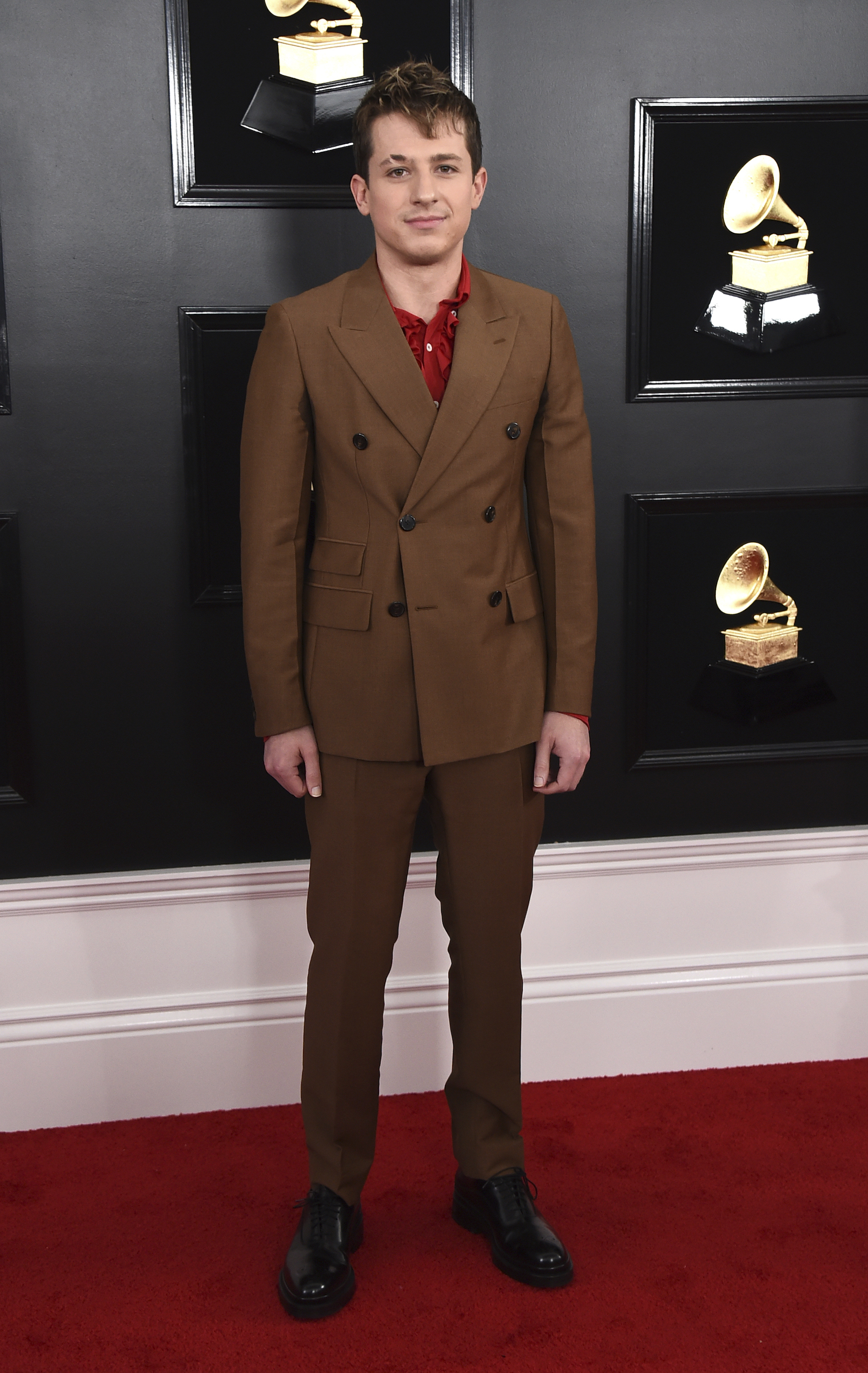 <div class='meta'><div class='origin-logo' data-origin='AP'></div><span class='caption-text' data-credit='Jordan Strauss/Invision/AP'>Charlie Puth arrives at the 61st annual Grammy Awards at the Staples Center on Sunday, Feb. 10, 2019, in Los Angeles.</span></div>