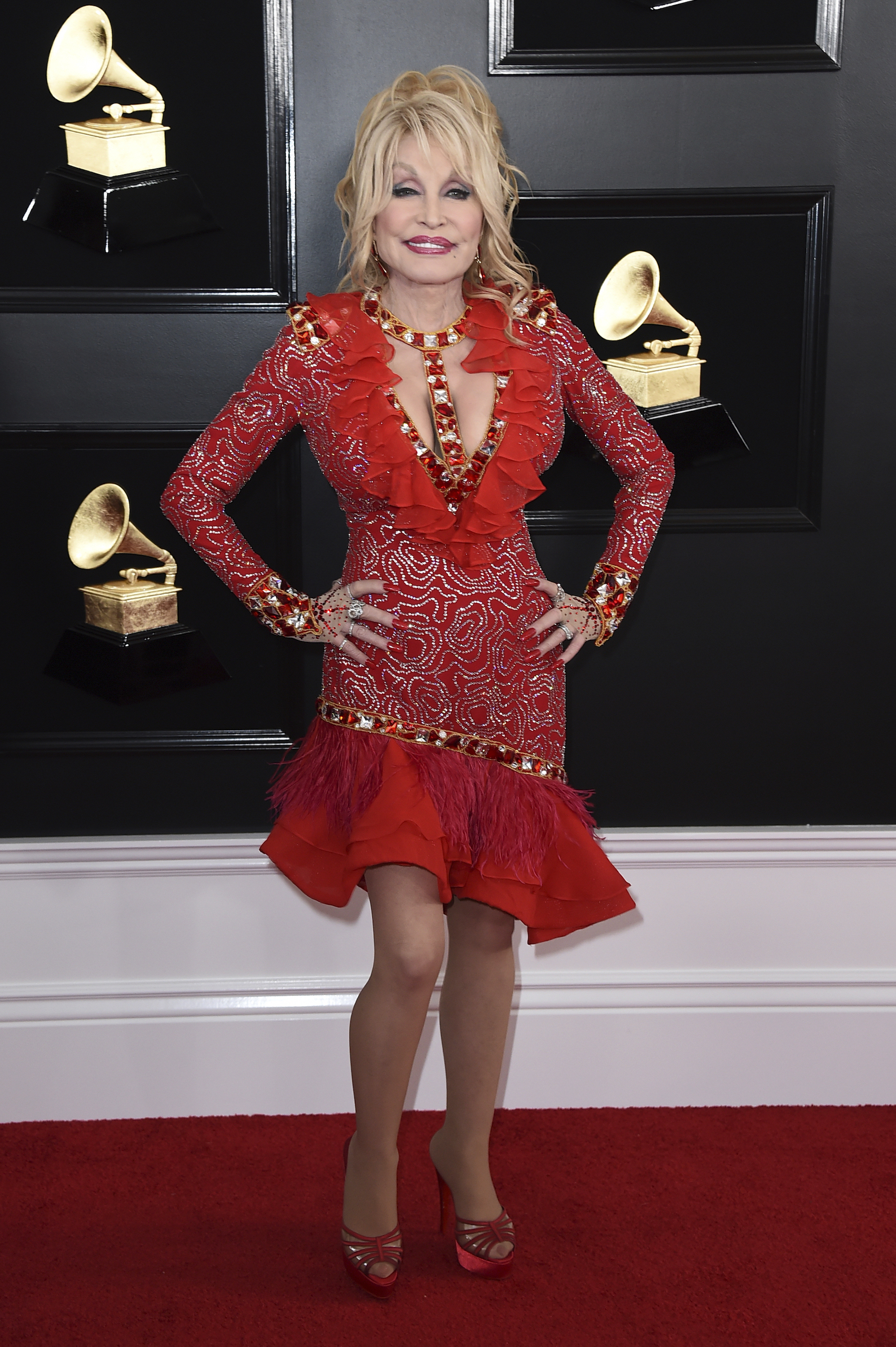 <div class='meta'><div class='origin-logo' data-origin='AP'></div><span class='caption-text' data-credit='Jordan Strauss/Invision/AP'>Dolly Parton arrives at the 61st annual Grammy Awards at the Staples Center on Sunday, Feb. 10, 2019, in Los Angeles.</span></div>