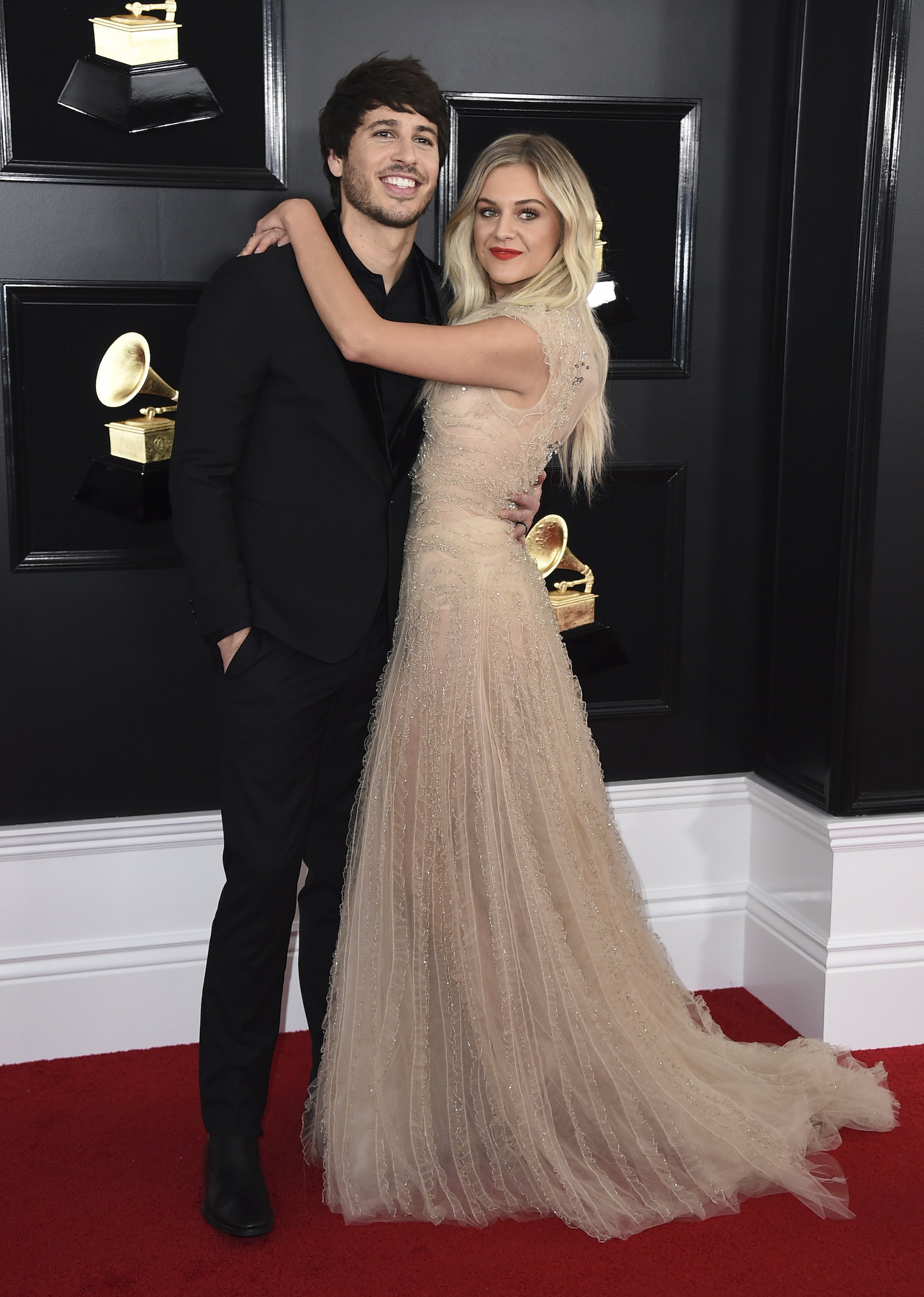 <div class='meta'><div class='origin-logo' data-origin='AP'></div><span class='caption-text' data-credit='Jordan Strauss/Invision/AP'>Morgan Evans, left, and Kelsea Ballerini arrive at the 61st annual Grammy Awards at the Staples Center on Sunday, Feb. 10, 2019, in Los Angeles.</span></div>
