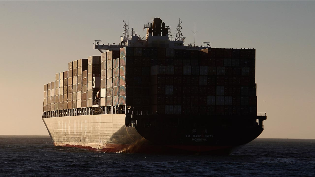 The Yang Ming Masculinity, YMMS cargo ship anchored off the Long Beach Harbor waits to be unloaded due to a labor dispute