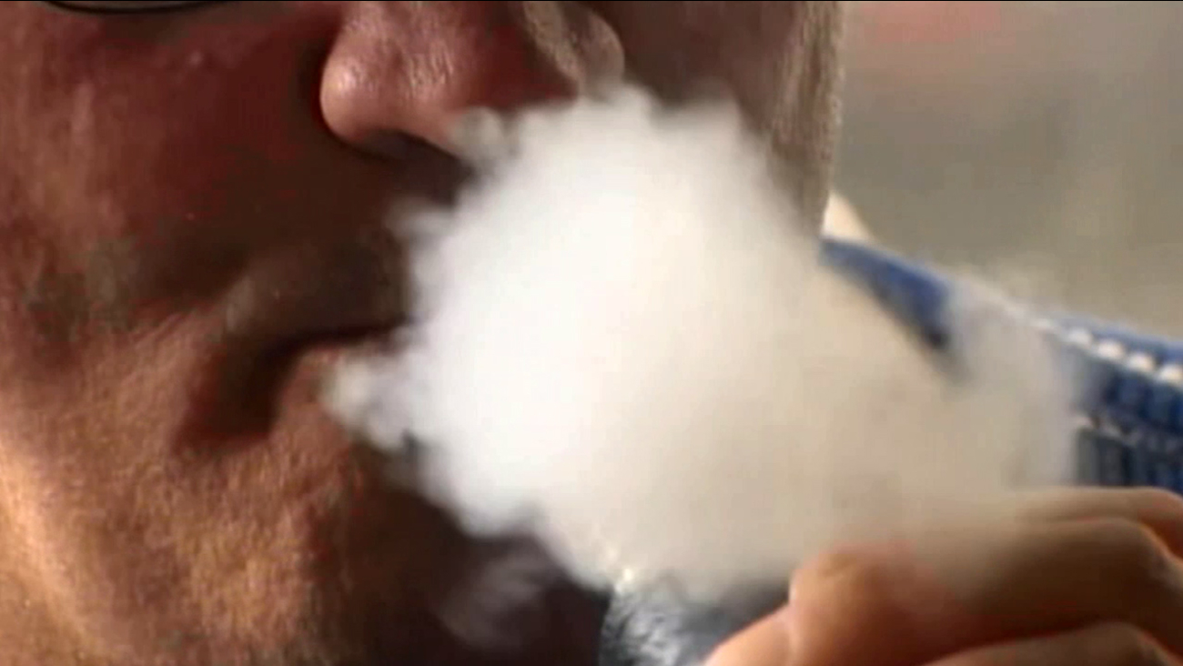 A man blows out smoke from an e-cigarette in this undated file photo.