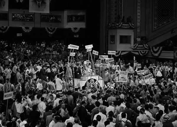 "<div class=""meta image-caption""><div class=""origin-logo origin-image none""><span>none</span></div><span class=""caption-text"">Delegates, yelling and cheering, hold their state banners high as they pass the speaker's rostrum during a tumultuous demonstration for Senator Alben W. Barkley of Kentucky. (Photo/Murray Becker)</span></div>"